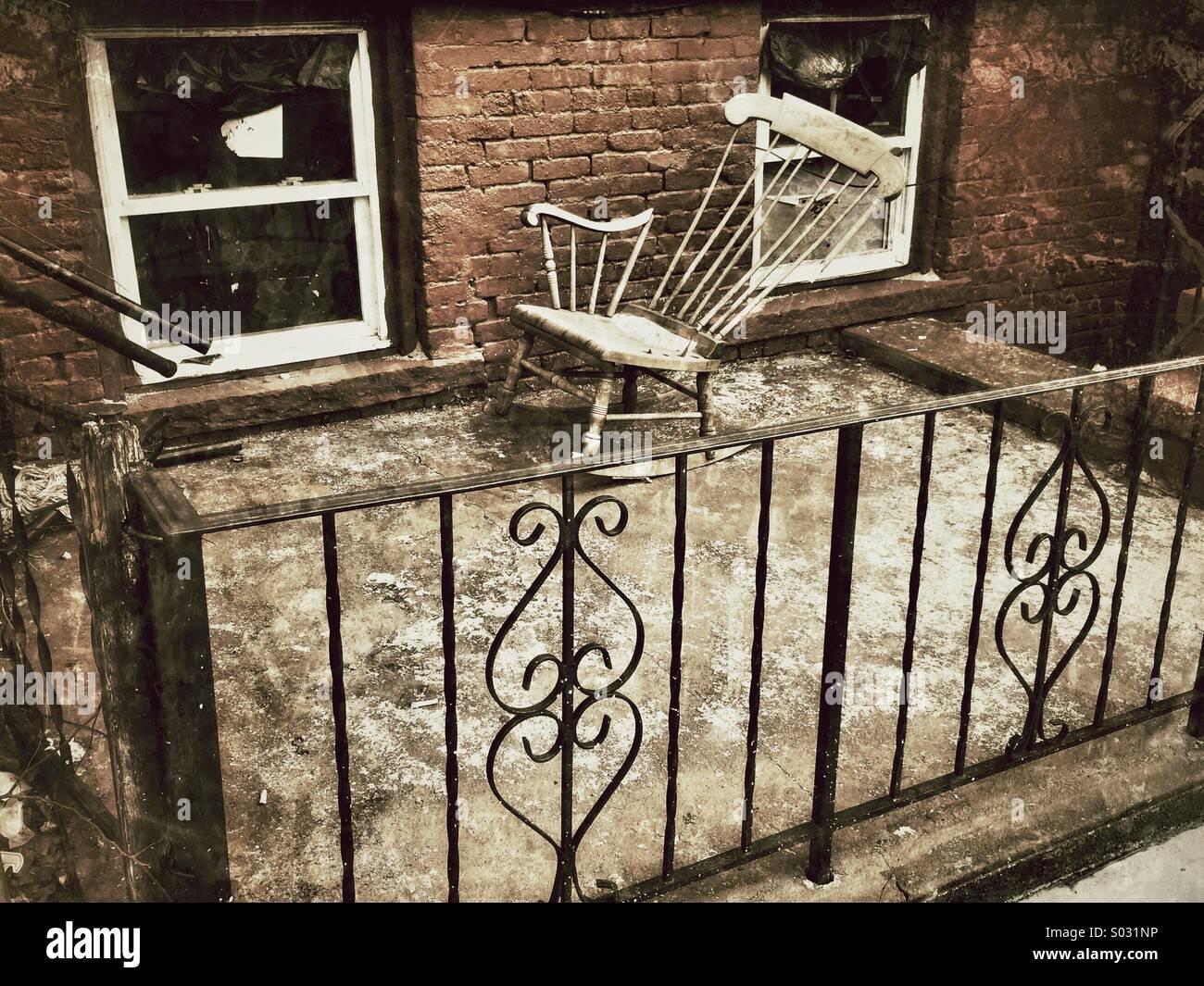 Broken Rocking Chair On Porch