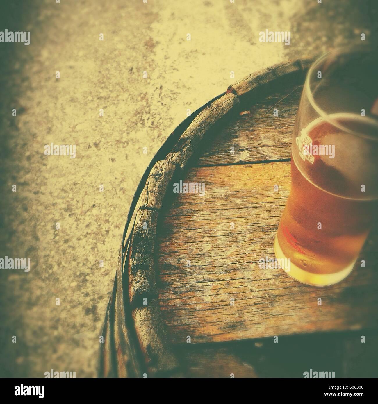 beer-glass-on-old-wooden-barrel-S06300.j