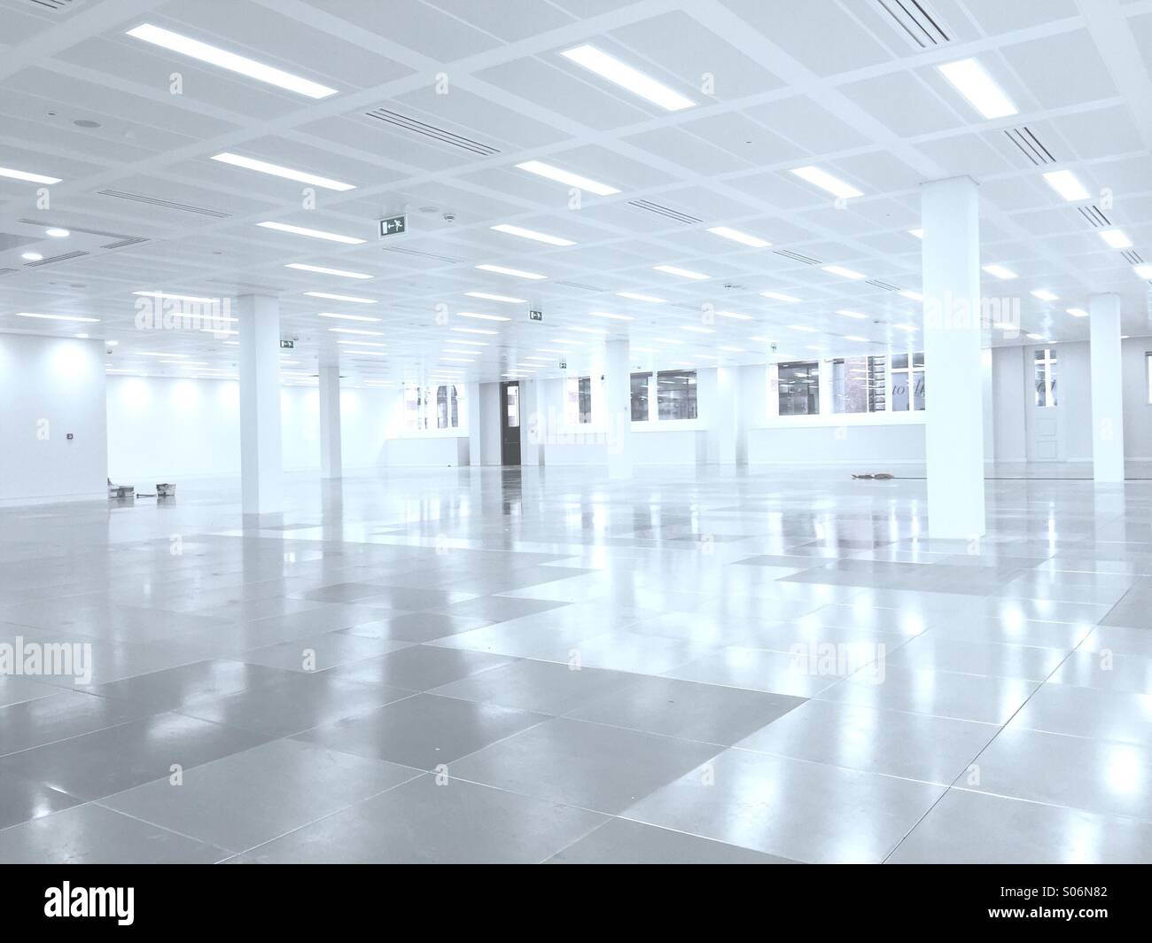 empty clean white office space with a futuristic feel blue white office space