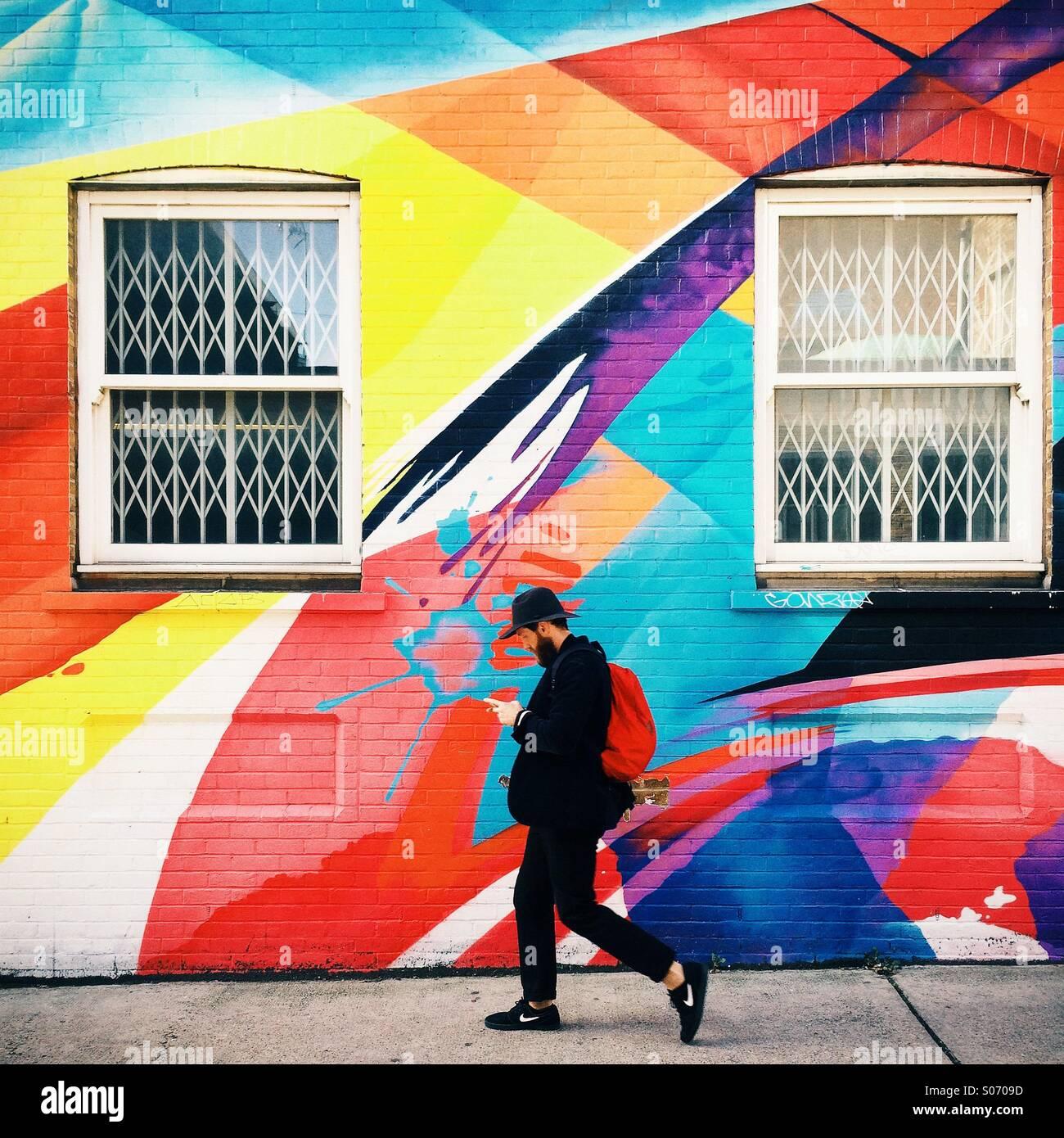man-walking-down-street-shoreditch-londo