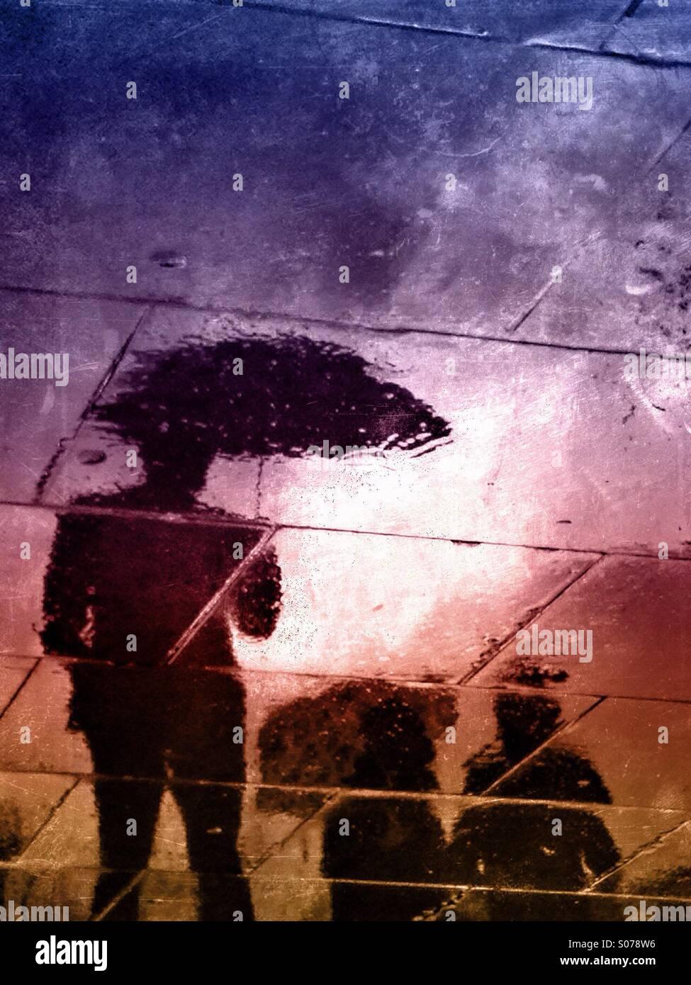 People_with_umbrellas_reflected_on_the_w