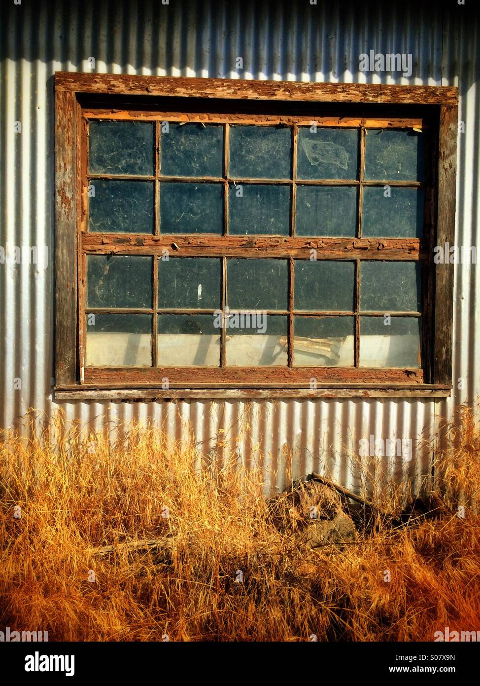 Corrugated metal building stock photos corrugated metal building an old window on a corrugated metal building stock image sciox Image collections