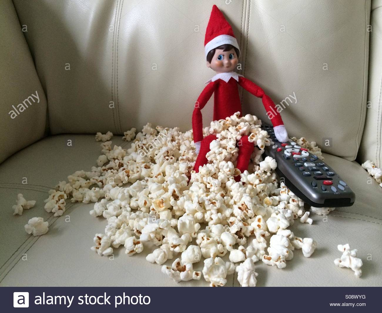 christmas-elf-watches-holiday-movies-on-