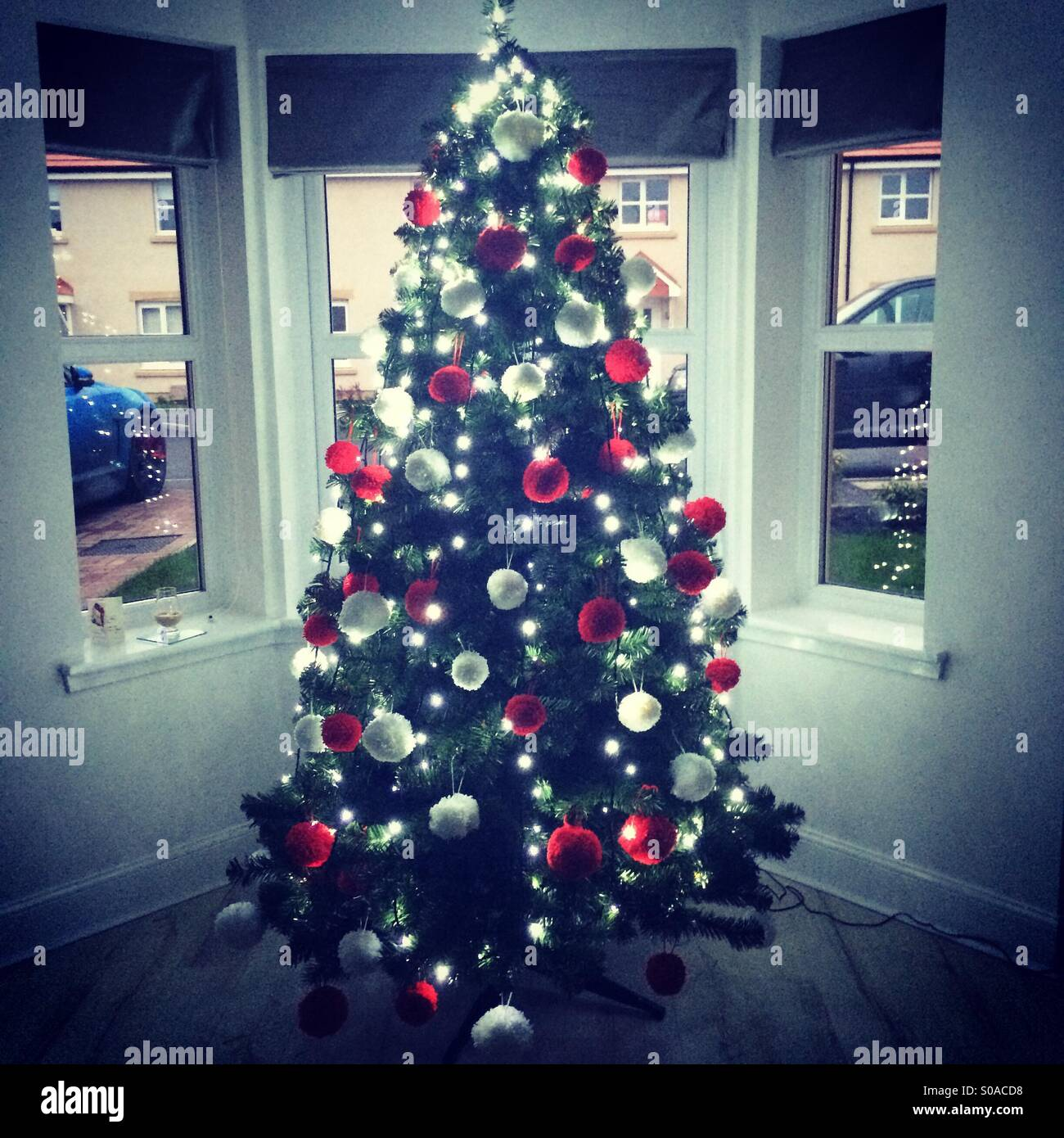 Christmas tree in a bay window stock photo royalty free
