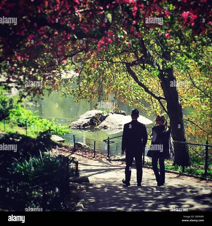 couple enjoying springtime in central park nyc stock photo