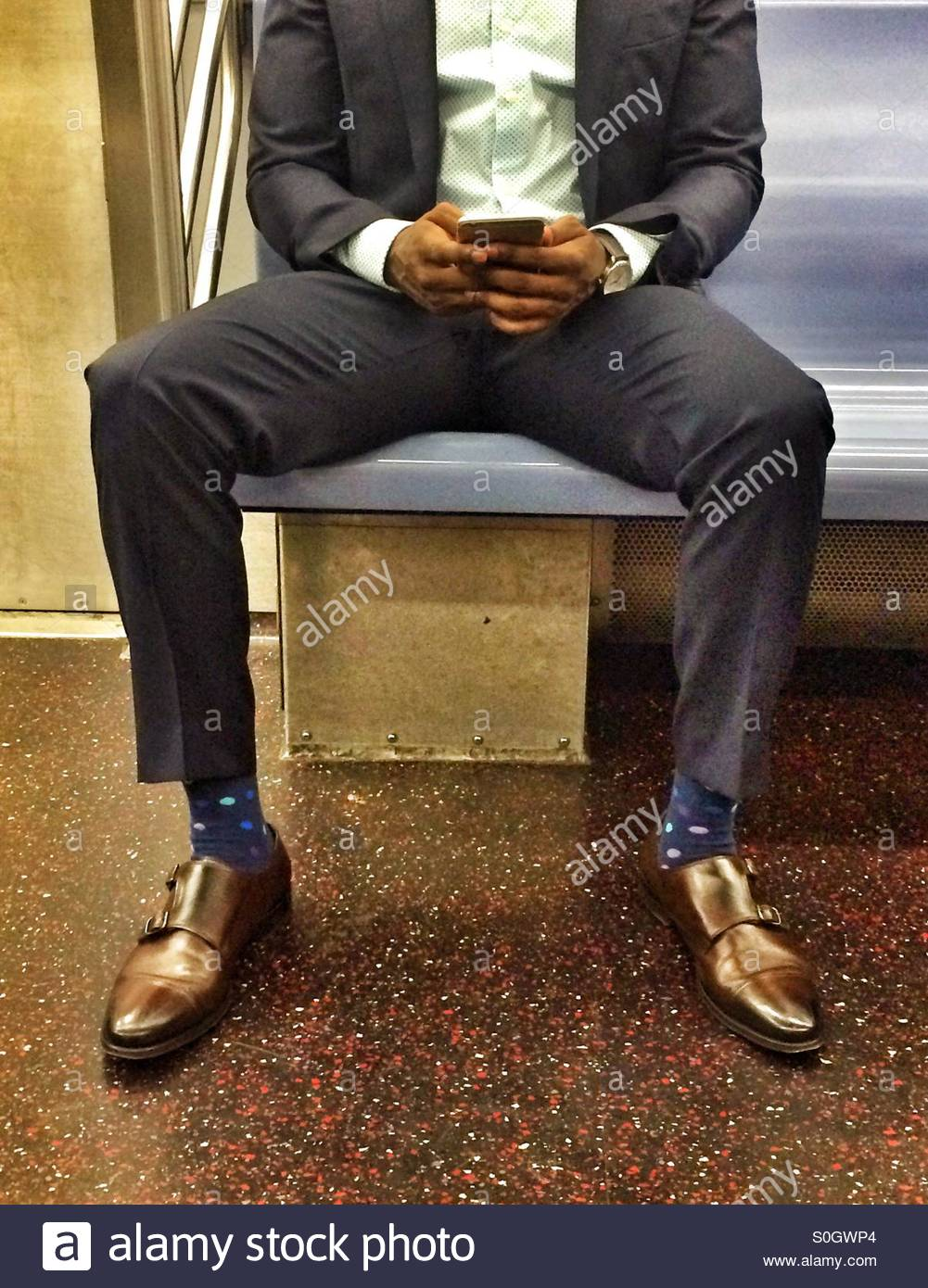 stylish-man-sitting-on-the-subway-with-a