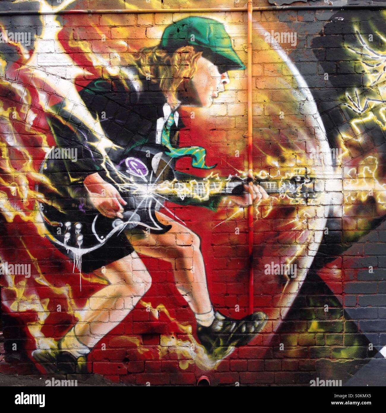 Ac Dc Art : Street art of angus young acdc band in lane