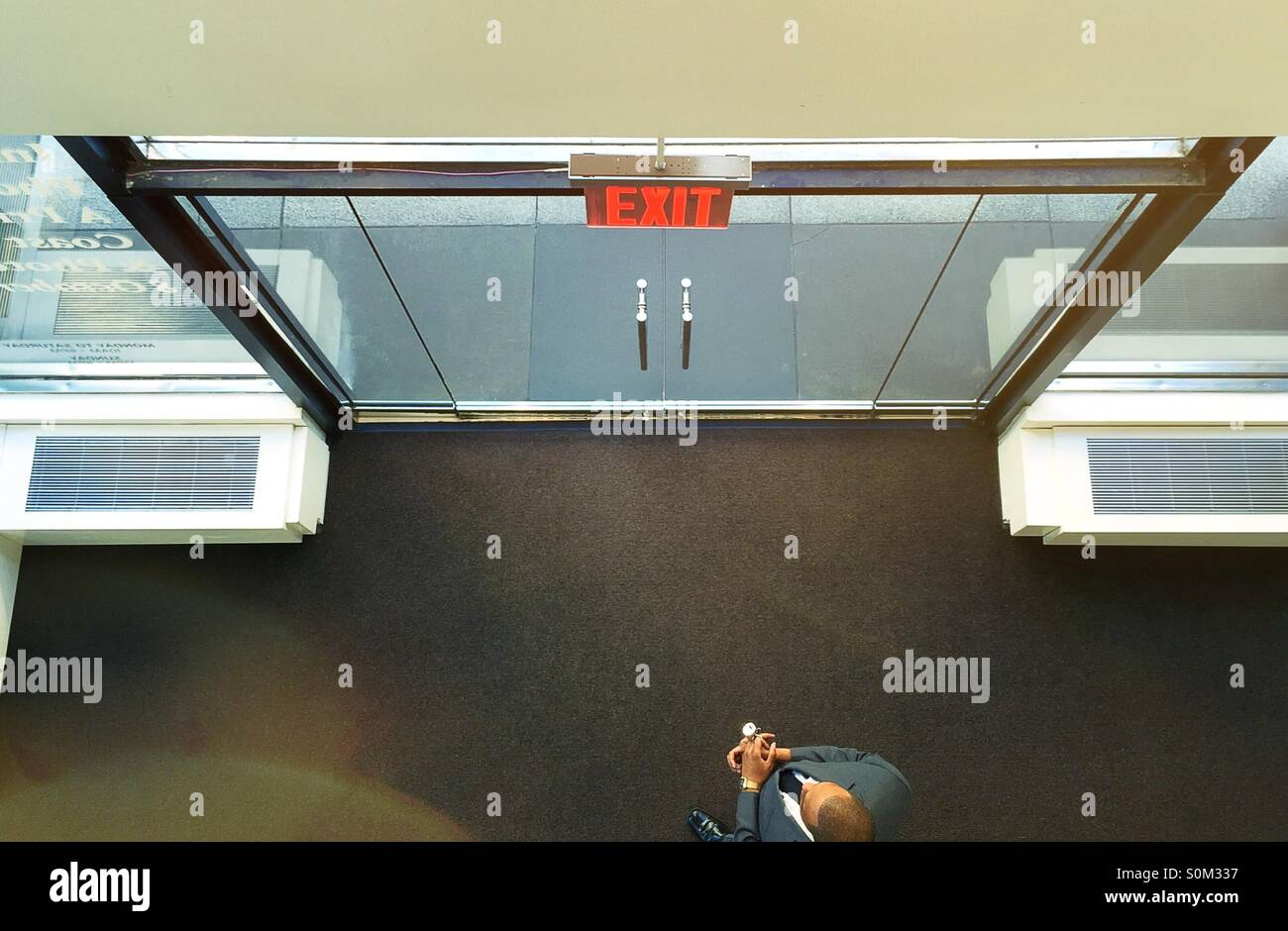 Double large glass doors and exit sign in high rise building in nyc double large glass doors and exit sign in high rise building in nyc planetlyrics Gallery