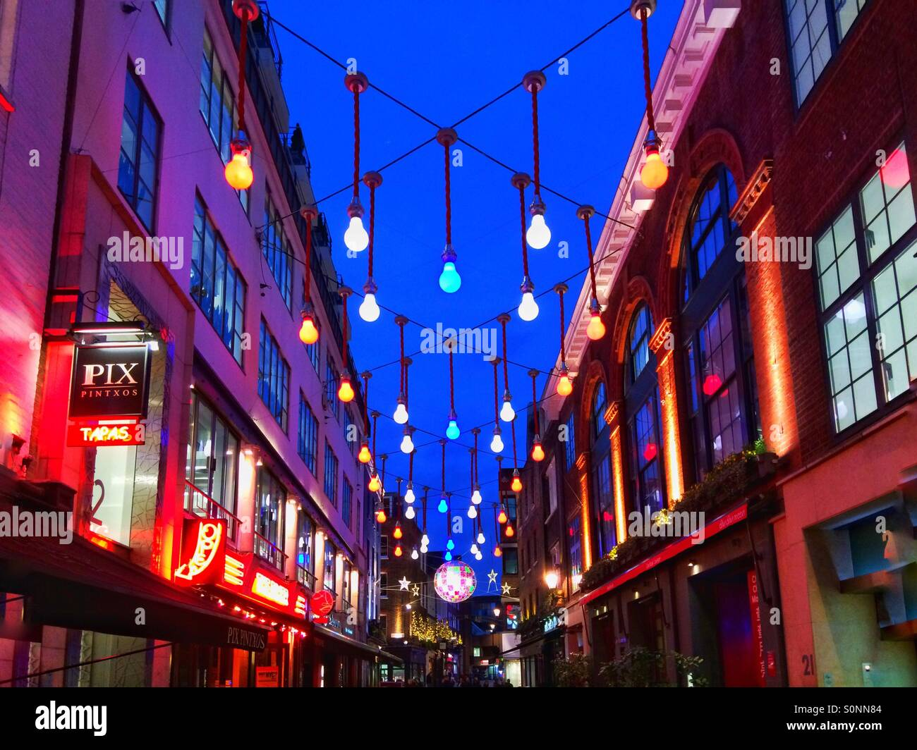 red white blue christmas lights over a street in london uk - Red White And Blue Christmas Lights