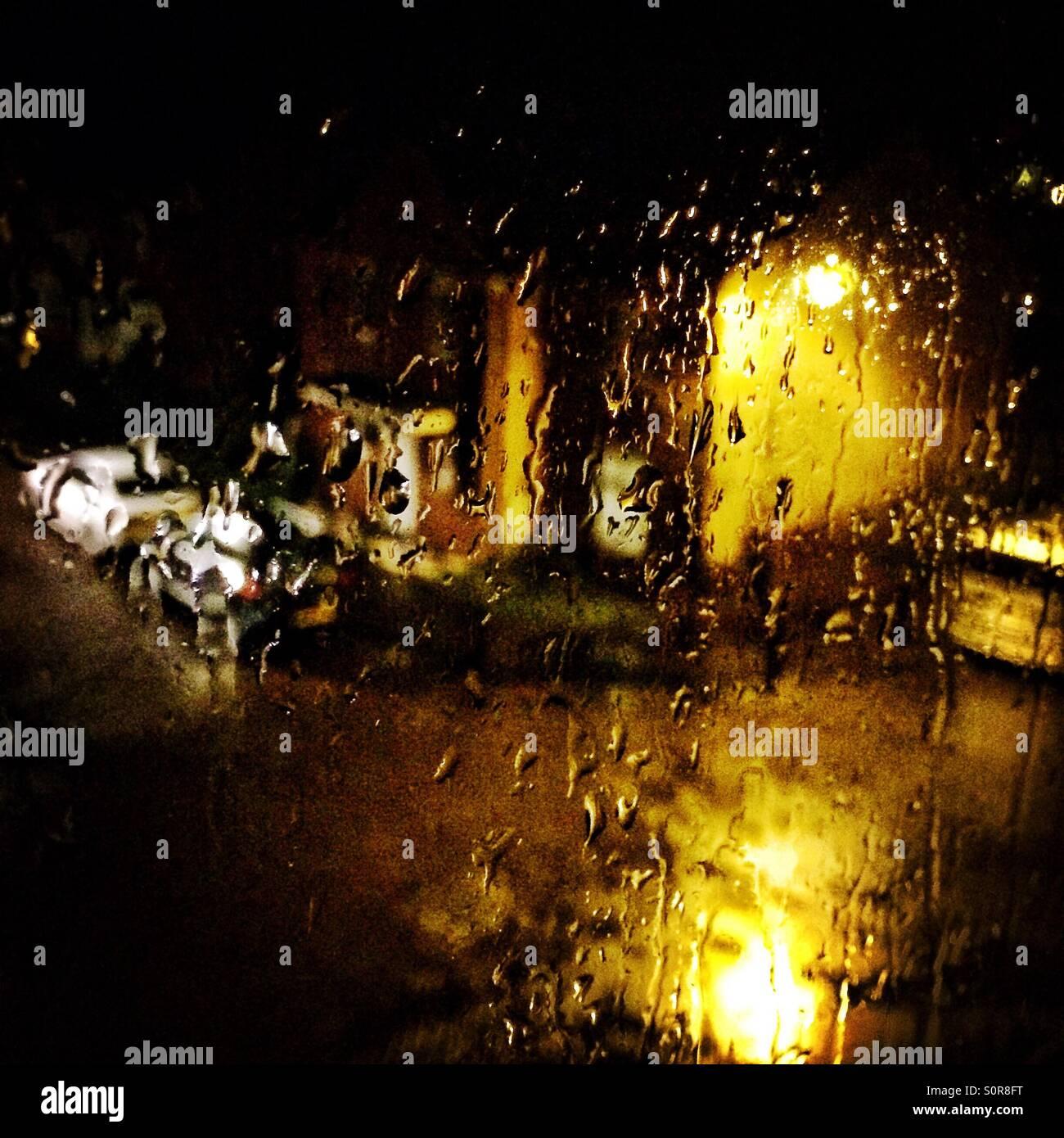 View Outside Window On A Dark Rainy Night