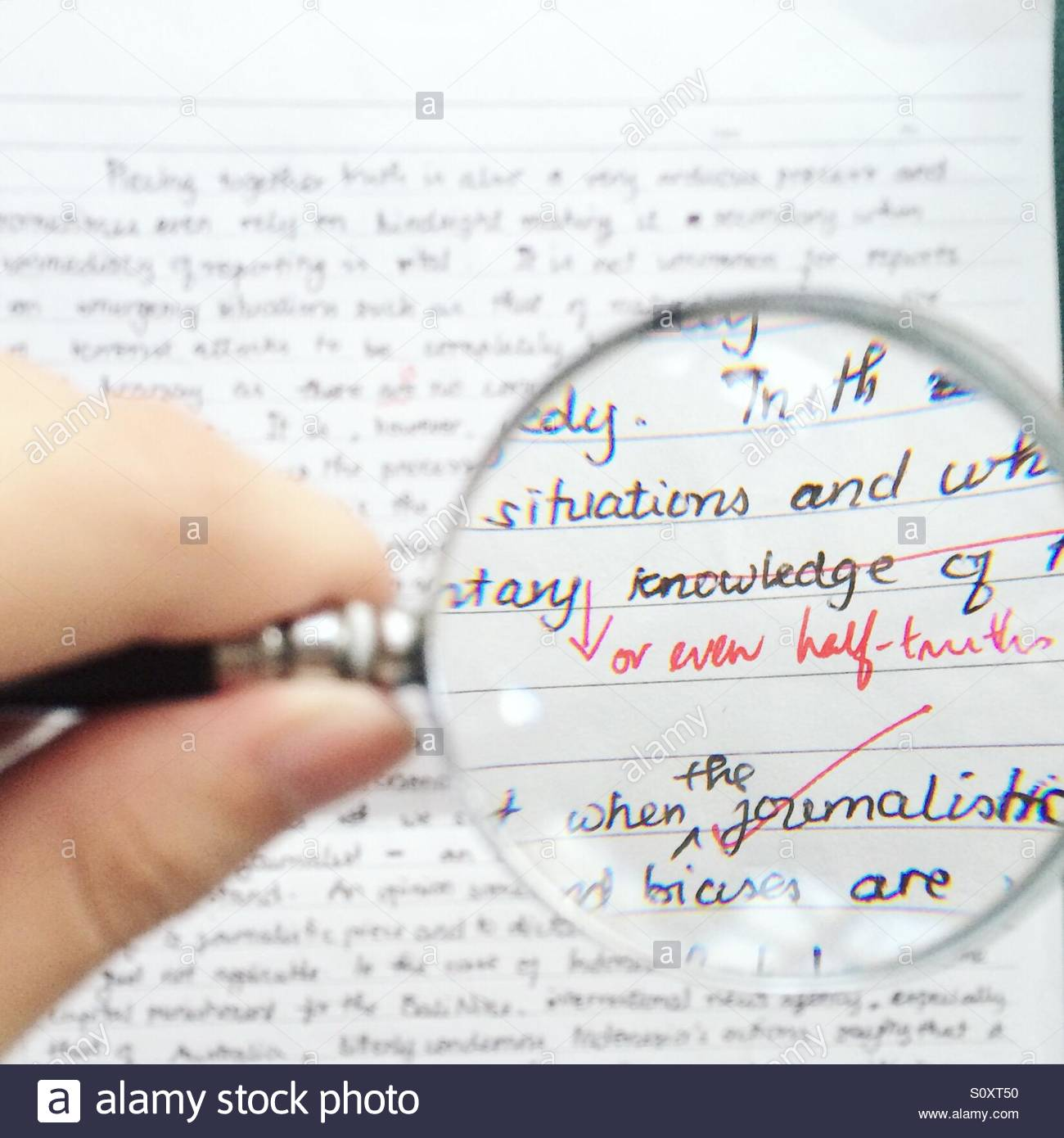 magnifying glass focusing on a marked english essay assignment magnifying glass focusing on a marked english essay assignment