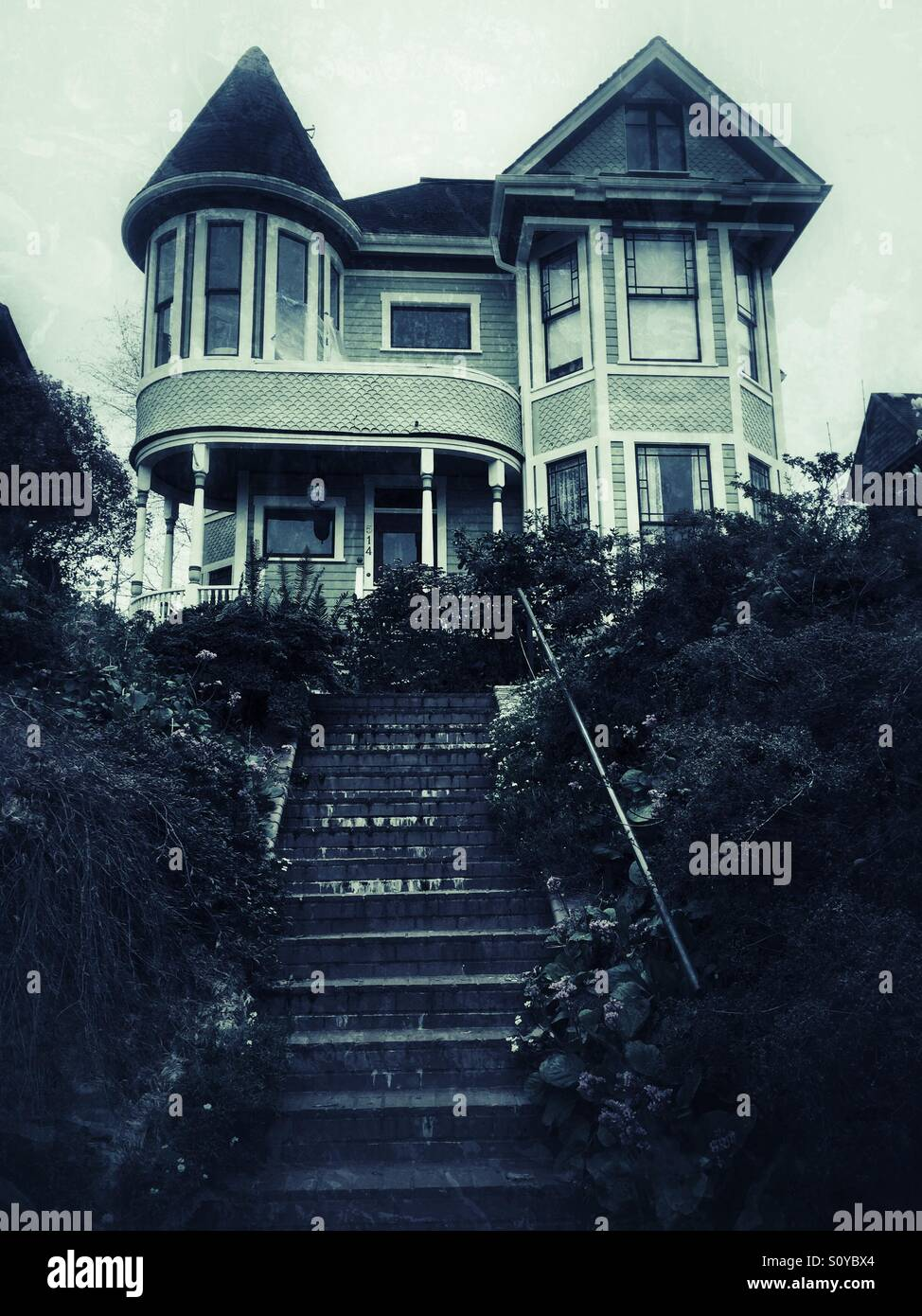 an old creepy victorian house on the hill stock photo royalty