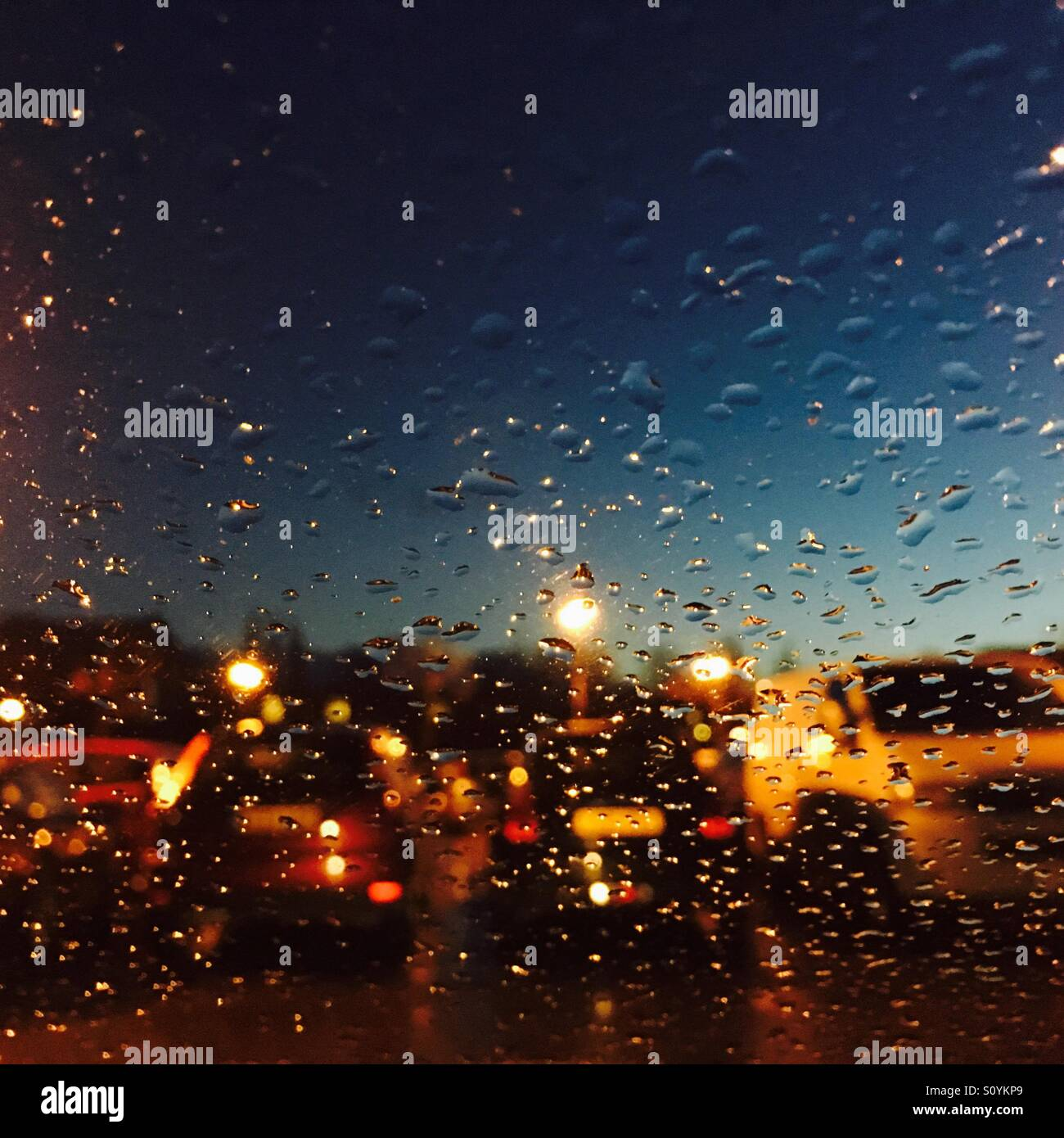 cars through a rain spattered car window at night stock photo royalty free image 310394849 alamy. Black Bedroom Furniture Sets. Home Design Ideas