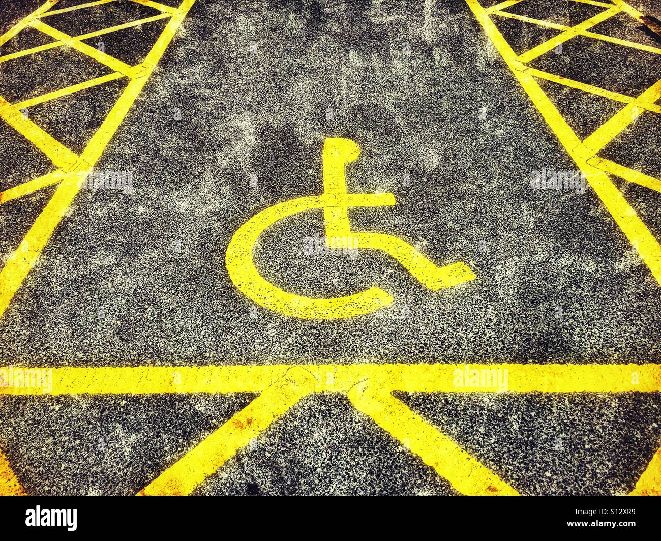A disabled parking space yellow lines and the symbol of a person a disabled parking space yellow lines and the symbol of a person using a wheelchair biocorpaavc