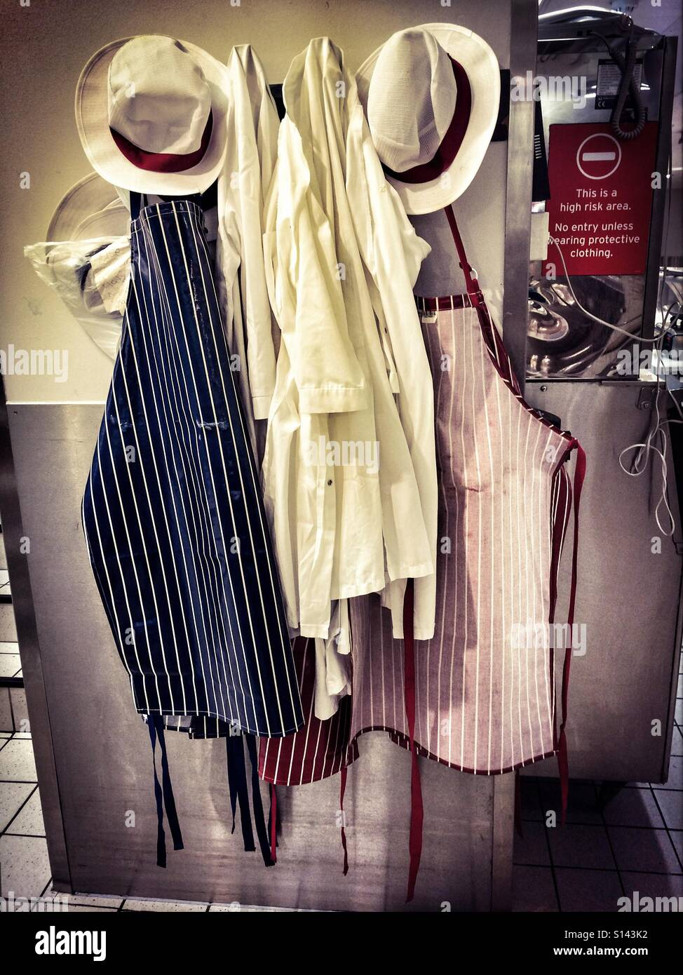 White apron sainsburys - Butcher S Aprons Hanging On A Peg In Sainsbury S Supermarket Stock Image