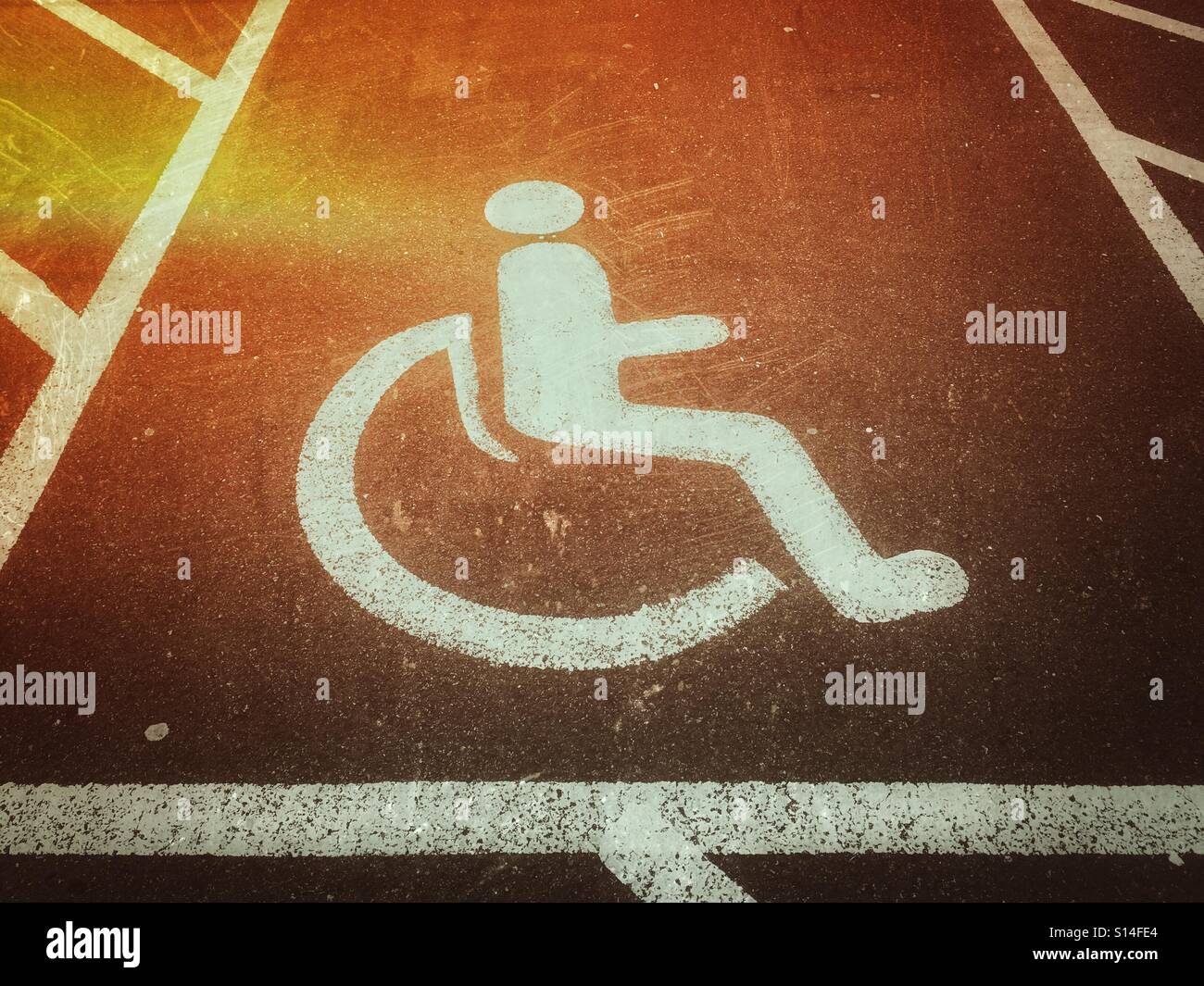 A light leak effect on photographic film of the parking space area a light leak effect on photographic film of the parking space area reserved for wheelchair users or those with a disability the symbol of a person sitting biocorpaavc
