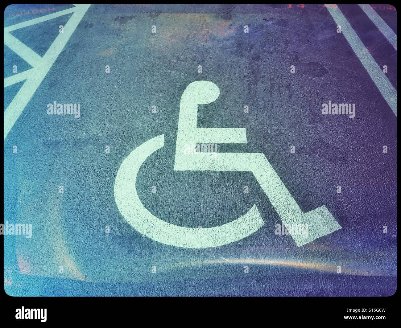 An analogue film effect image of a disabled persons car parking an analogue film effect image of a disabled persons car parking space the sign of a person sitting on a circle signifies a wheelchair user buycottarizona