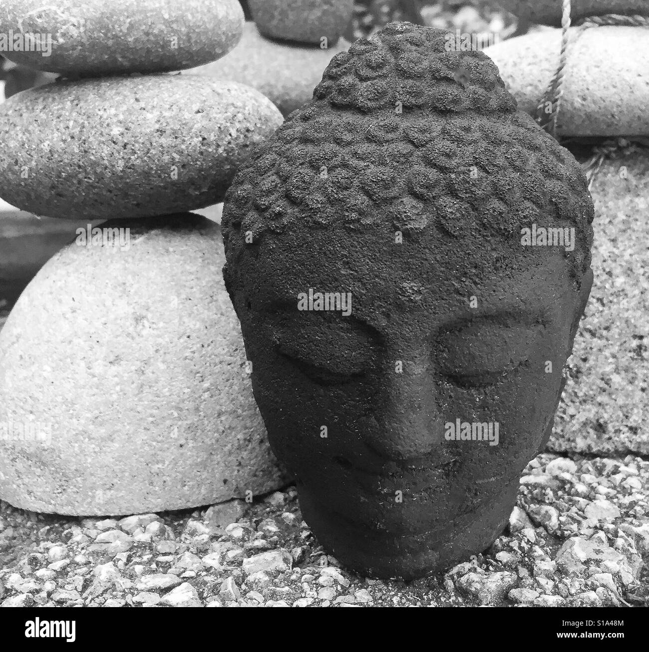 A Zen Moment In A Rock Garden With A Buddhist Statue Stock Photo Royalty Free Image 310624180