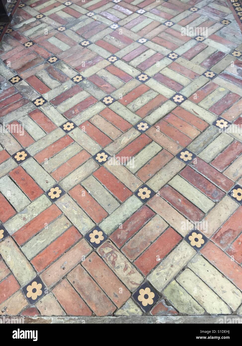Brick and ceramic tile floor with red and cream bricks with small brick and ceramic tile floor with red and cream bricks with small floral tiles in geometric pattern dailygadgetfo Gallery