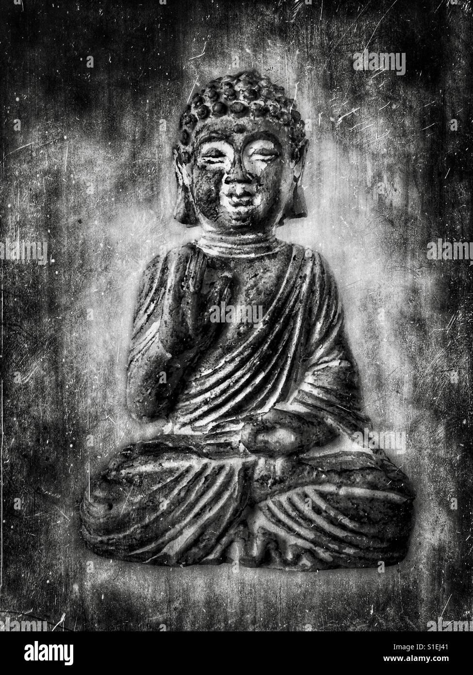 Black and white photo of a buddha statue against a scratched black and white photo of a buddha statue against a scratched textured background the buddha displays the vitarka mudra hand gesture which symbolises buycottarizona