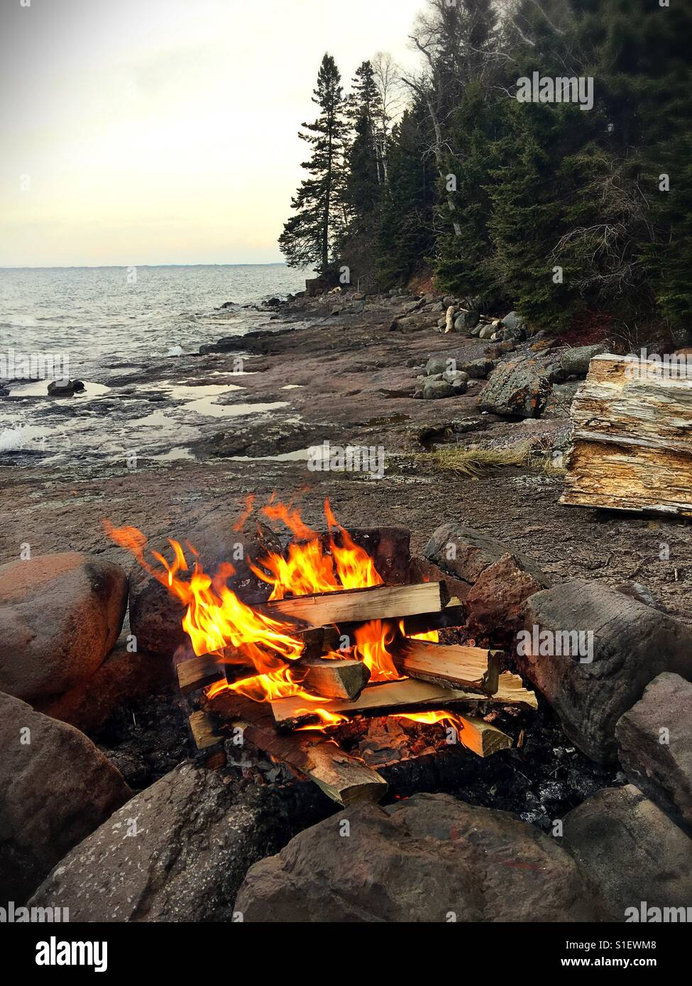A roaring camp fire on the shore of lake Superior Stock ...