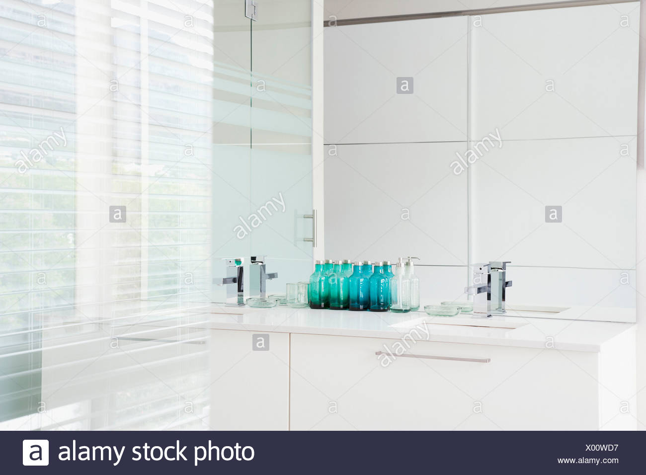 Glass walls and sink in modern, white bathroom Stock Photo ...