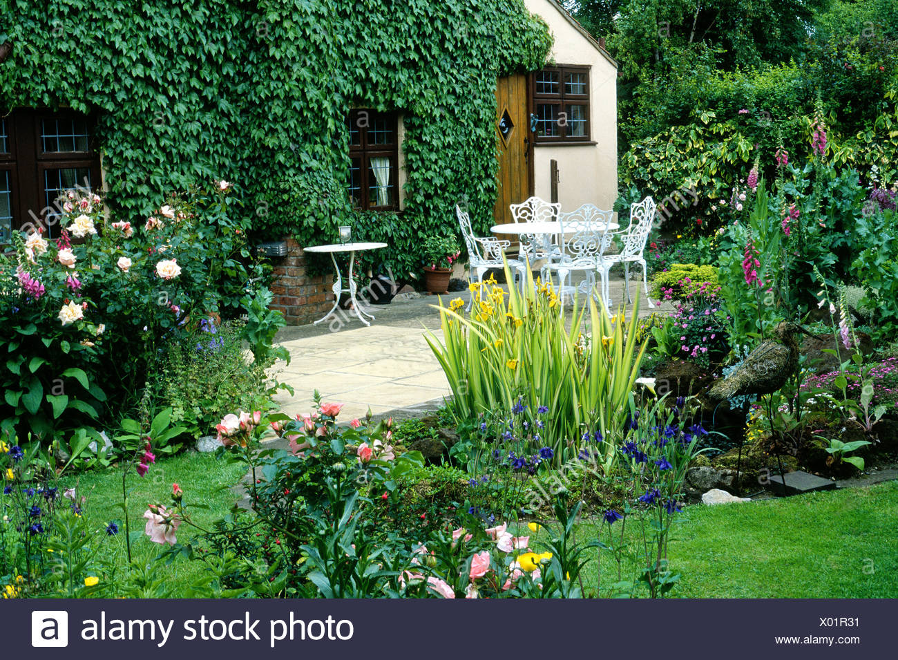 Pond Patio House And Small Garden Plants Flowers Table Chairs Furniture  Cottage Garden Iris Design Gardens Patios