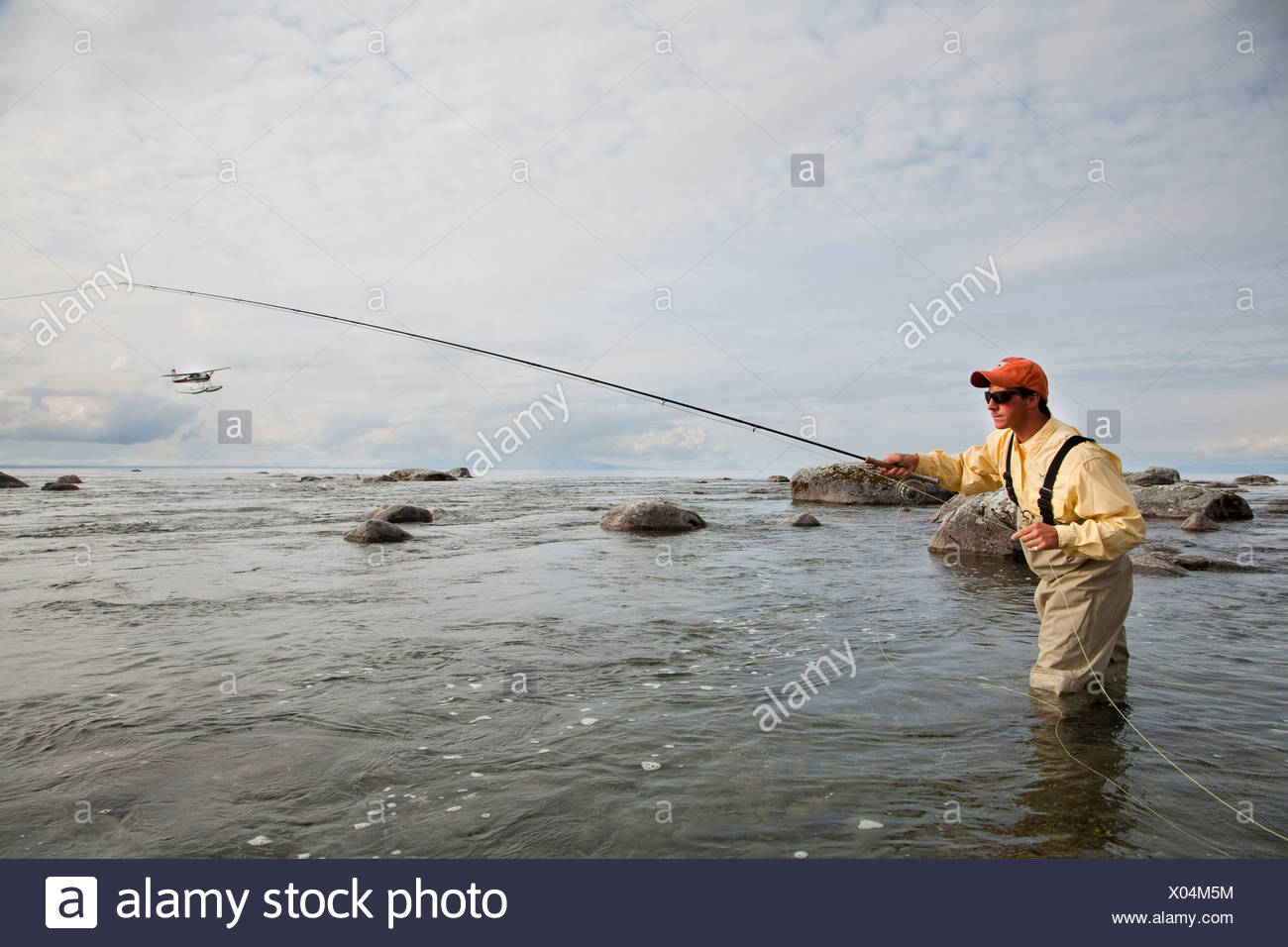 Angler stock photos angler stock images alamy for Fly fishing bay area