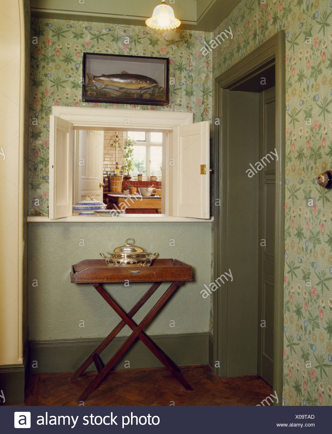 Butlers Tray Below Open Hatch In Hall With Green Wallpaper