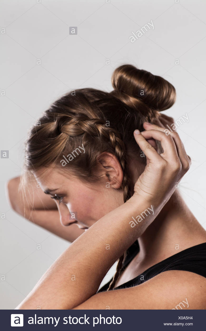 Instructions braided hairstyle with bun step 3 of 3 Stock Photo ...