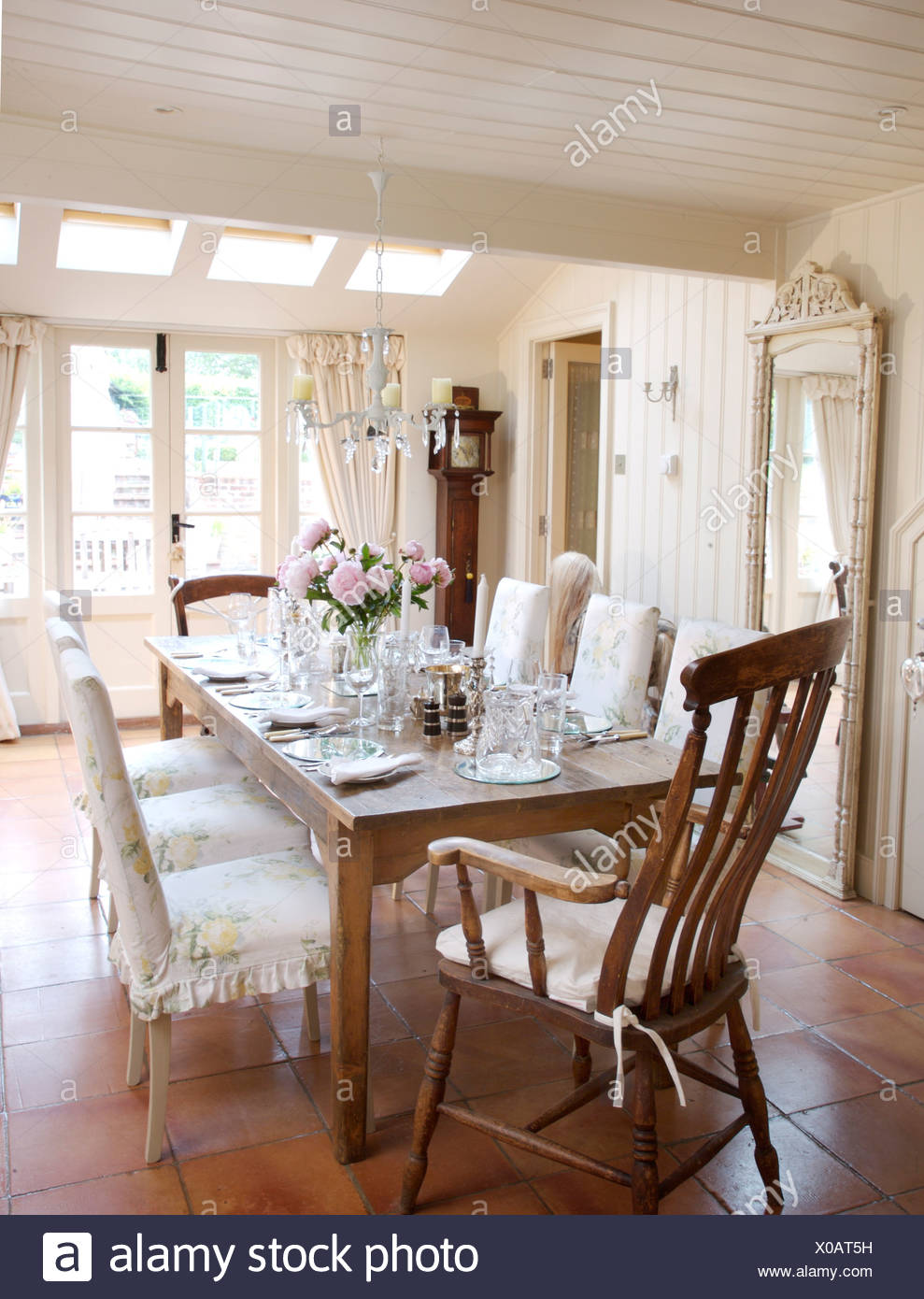 Antique Windsor Carver Chair And Chairs With Loose Covers At Simple Wooden  Table Set For Lunch For Eight In Country Dining Room