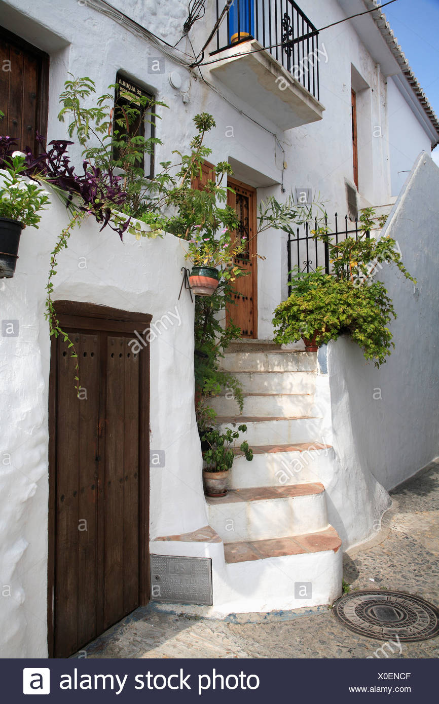 Traditional White Spanish House With Steps Leading Up To Front Door