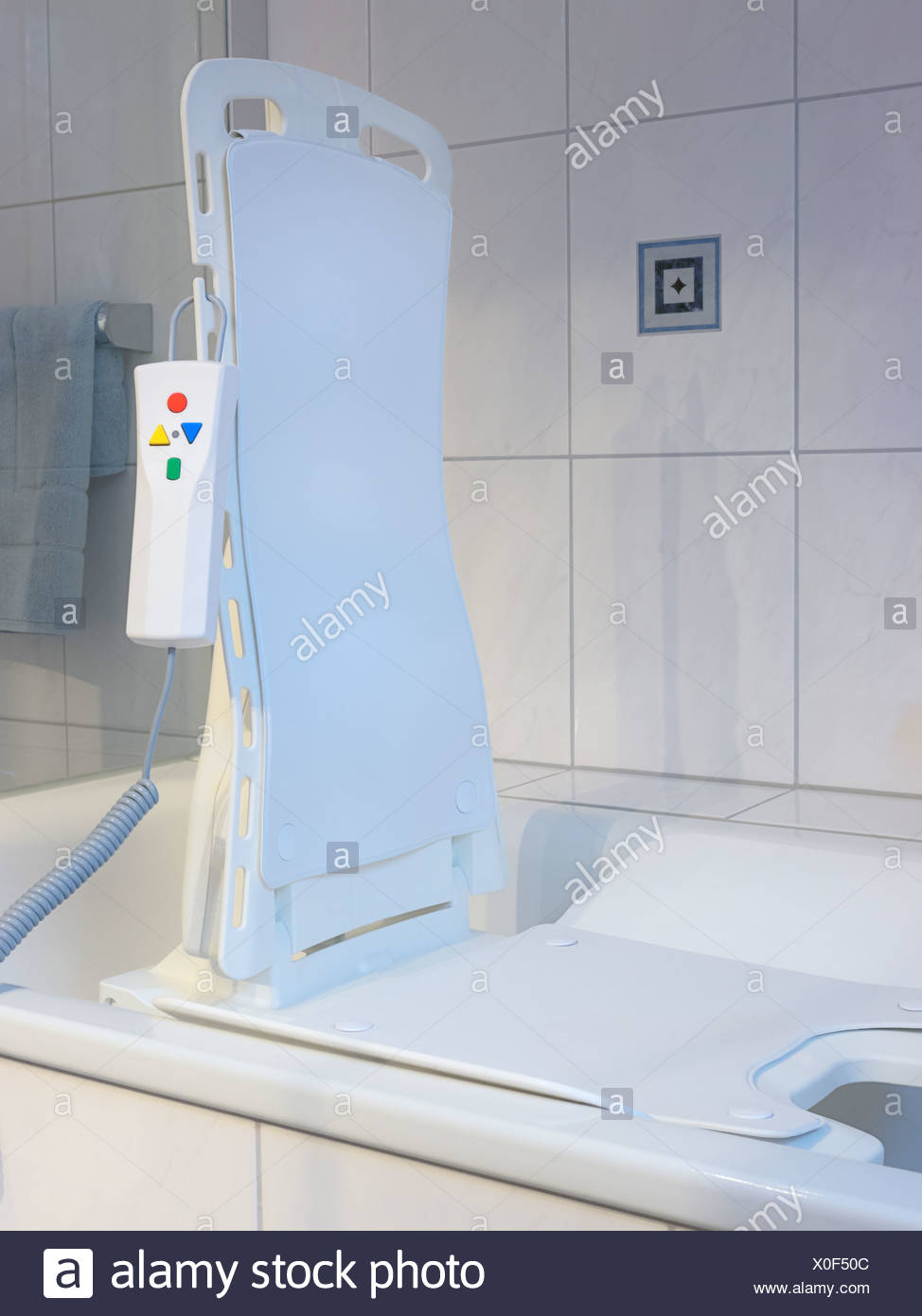 Battery-powered bath lift with an electric motor and a remote ...