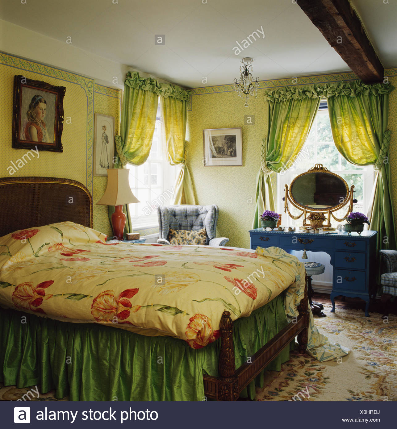 Pale Green Curtains On Window In Pale Yellow Bedroom With Floral Patterned  Quilt And Green Valence On Bed