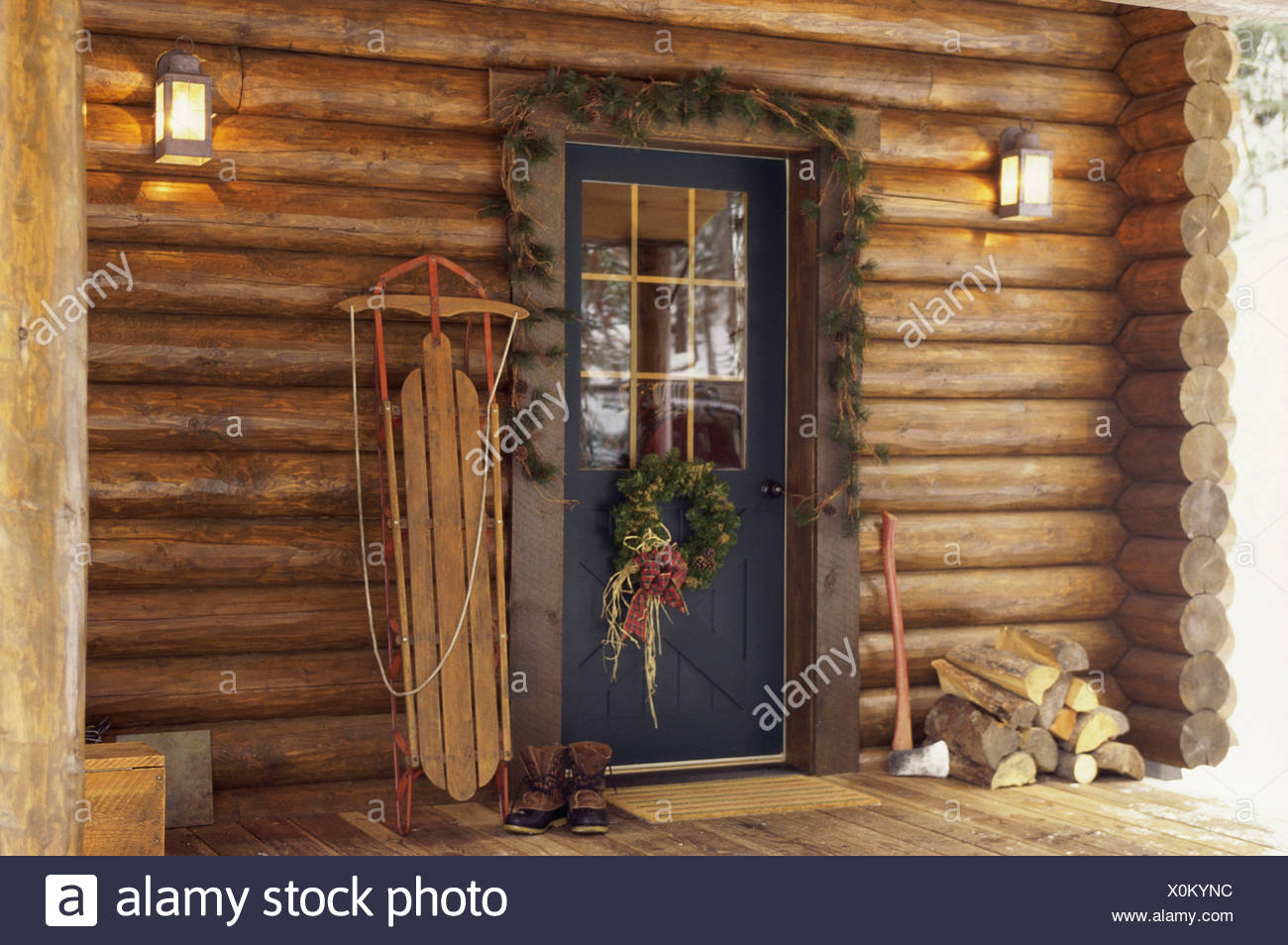 christmas decorations around a log cabin door - Cabin Christmas Decor