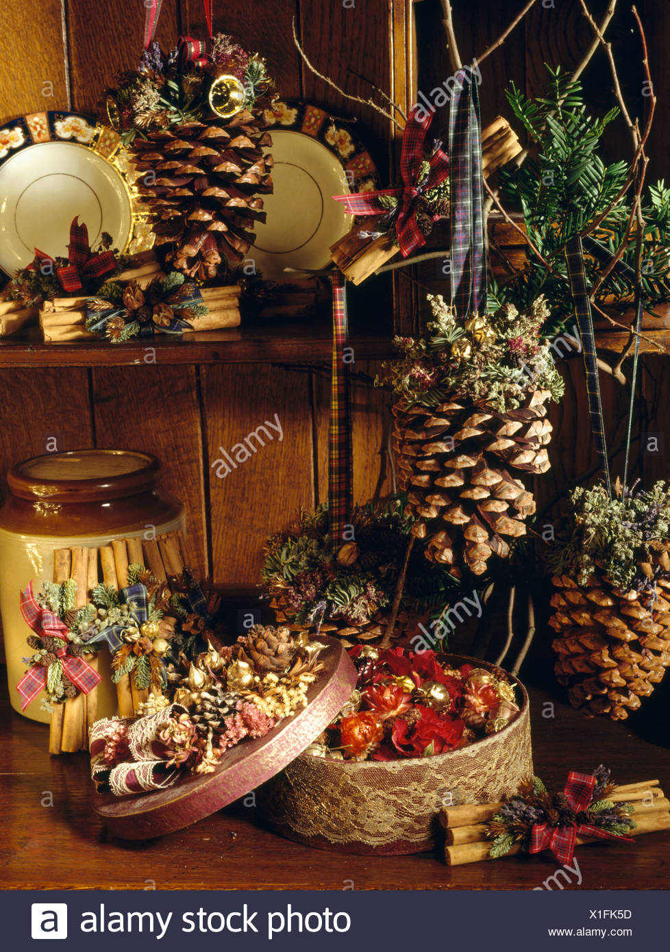 close up of home made christmas decorations of pine cones and baskets decorated with dried flowers
