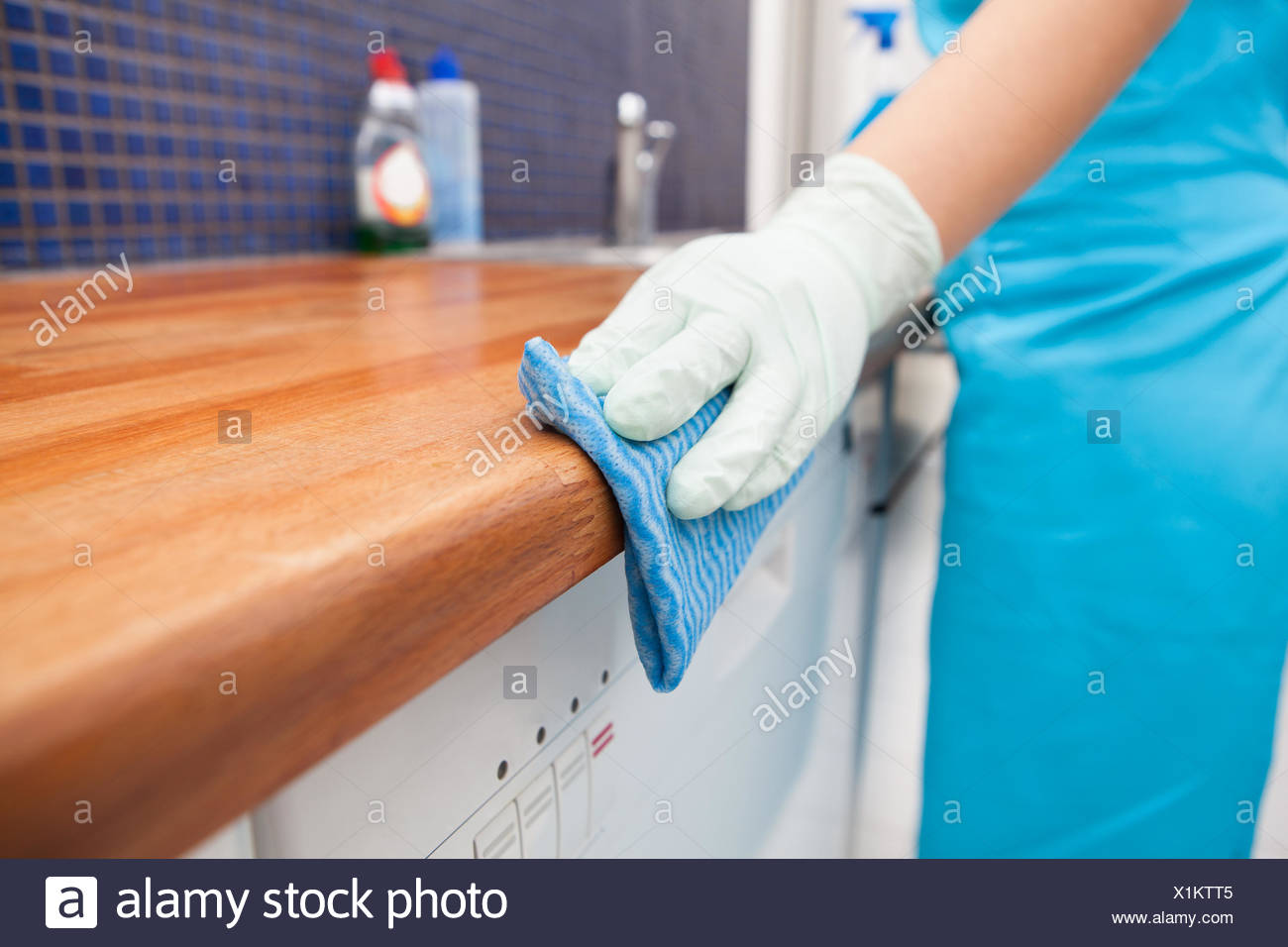 Closeup Of Young Woman Wearing Apron Cleaning Kitchen Worktop Stock ...