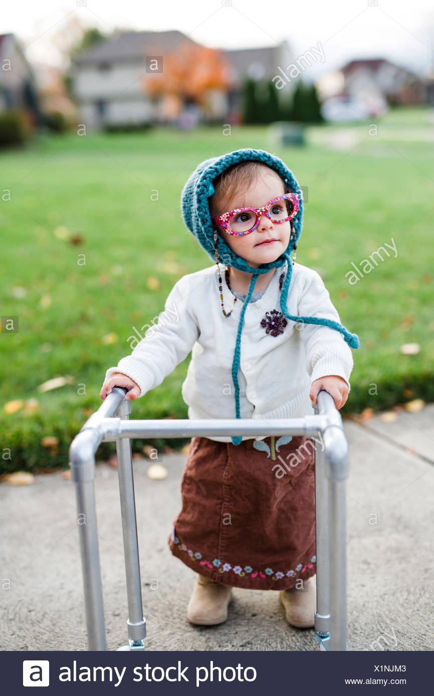 source a toddler girl wearing a halloween costume of an elderly woman in a
