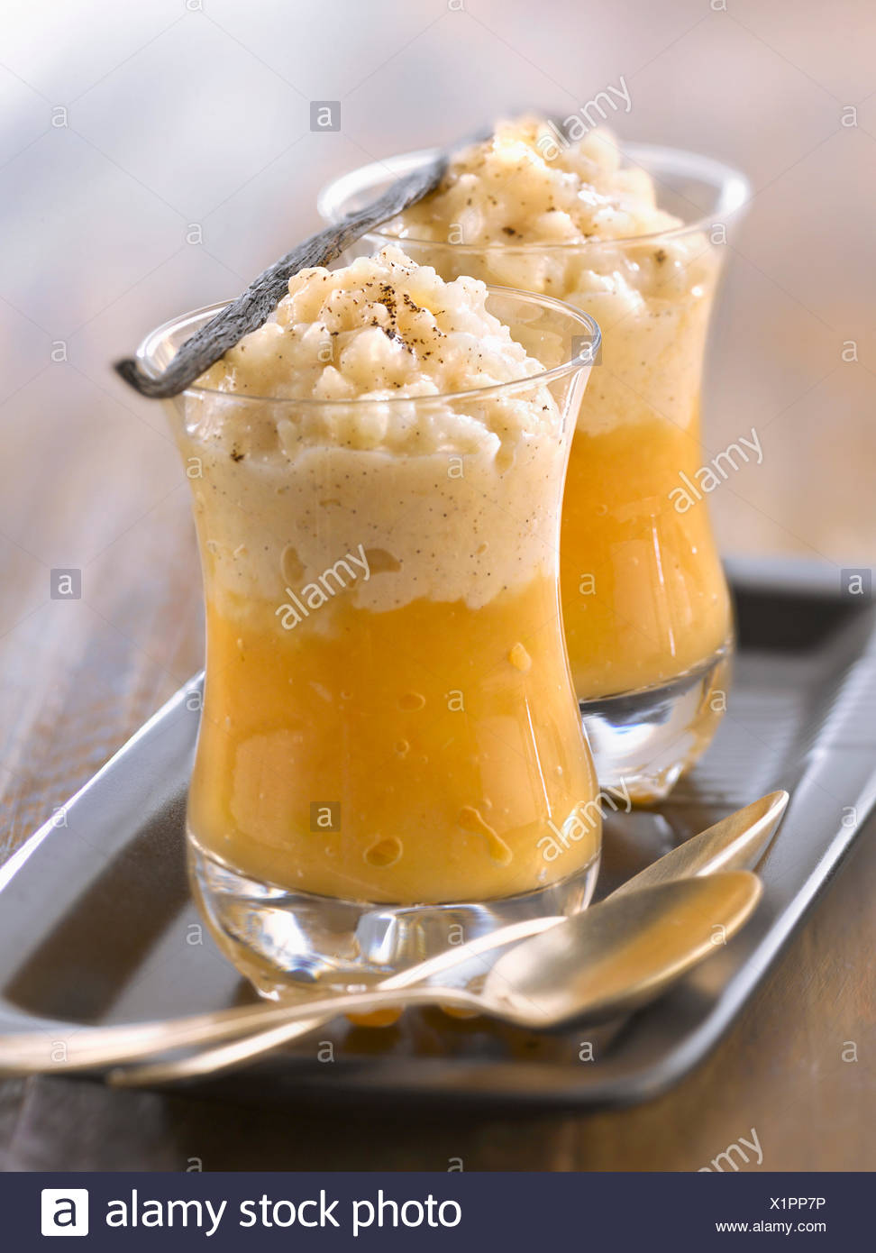Quince stock photos quince stock images alamy vanilla flavored rice pudding with stewed quince stock image biocorpaavc Image collections