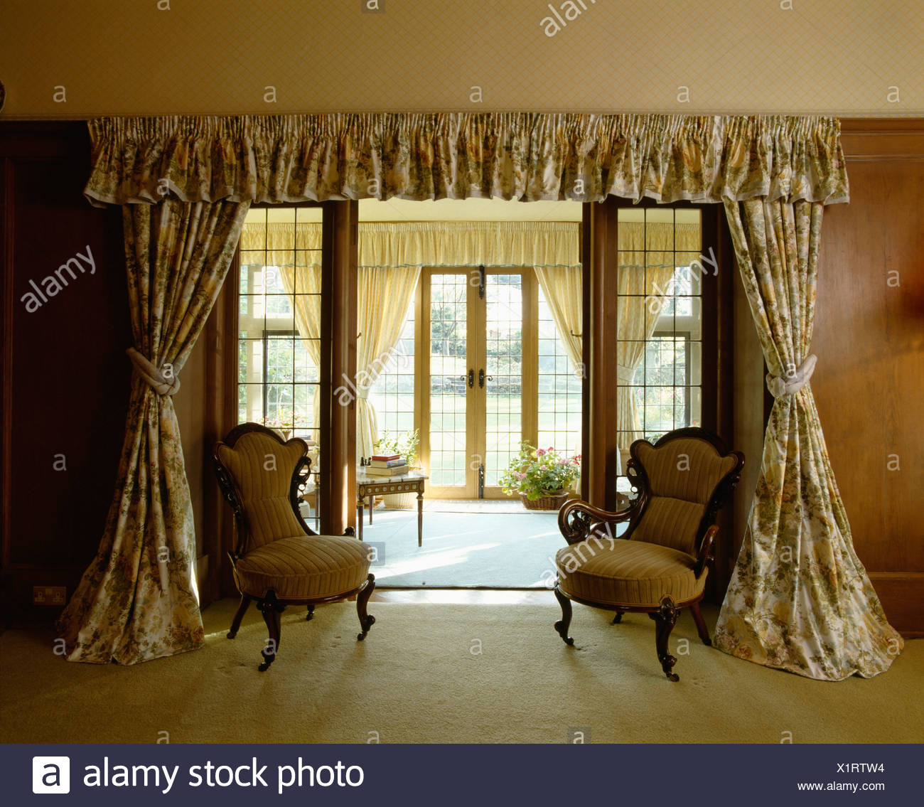 Patterned Drapes And Internal Double Glass Doors In Sittingroom With