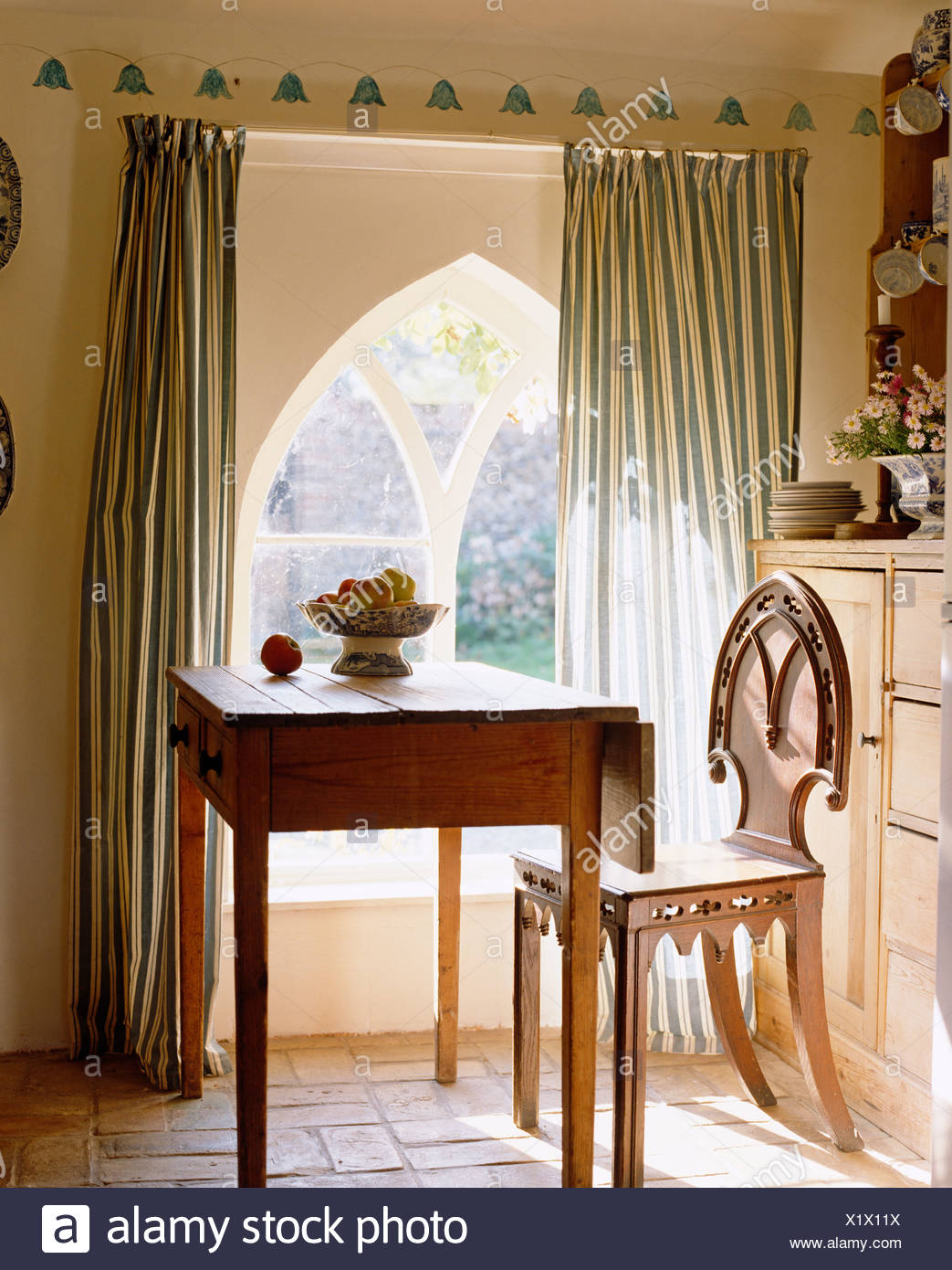 Gothic style chair stock photos gothic style chair stock for Chair next to window