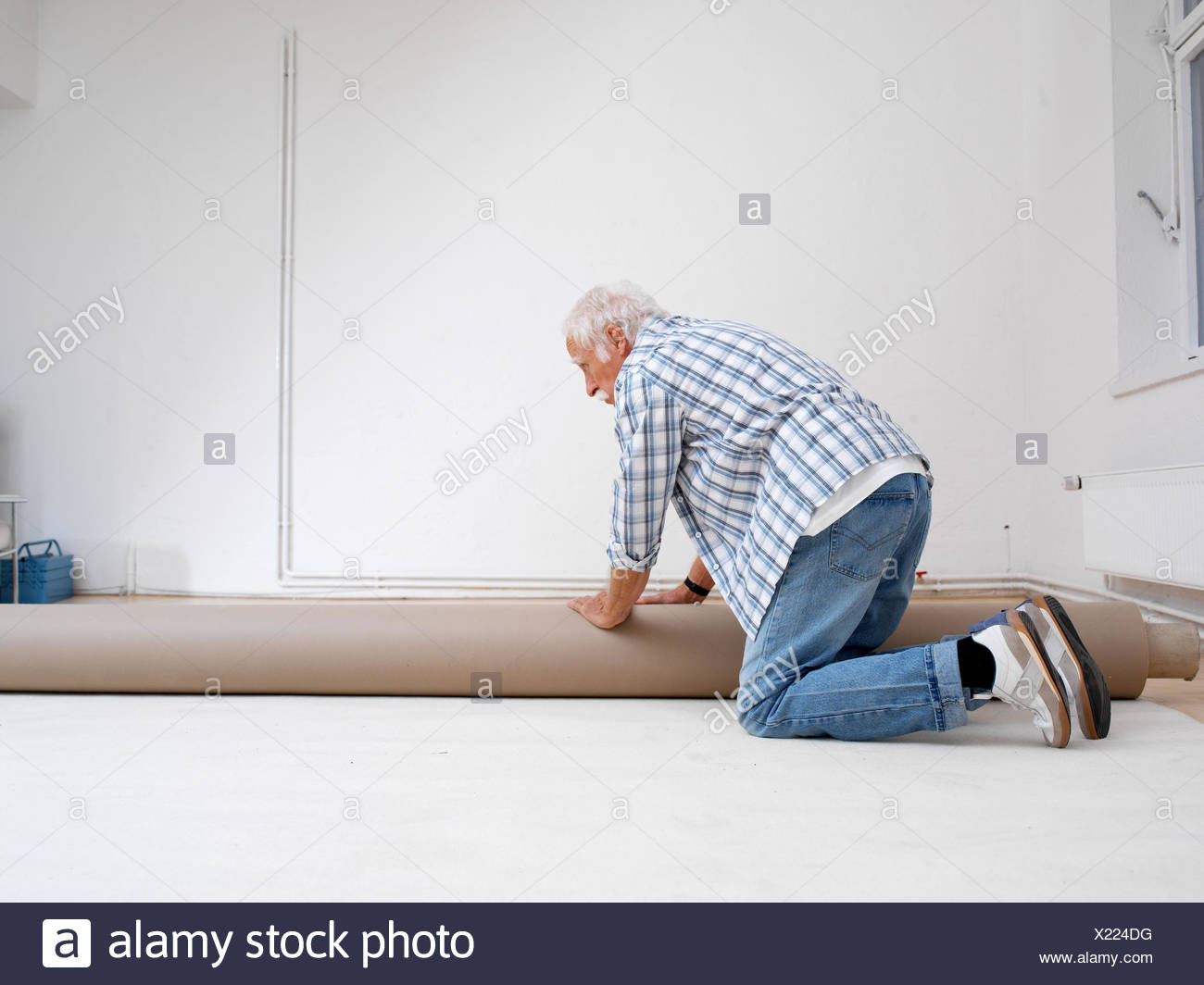 Do it yourselfers stock photos do it yourselfers stock images flat renovation works senior carpet lay 60 70 years solutioingenieria Gallery