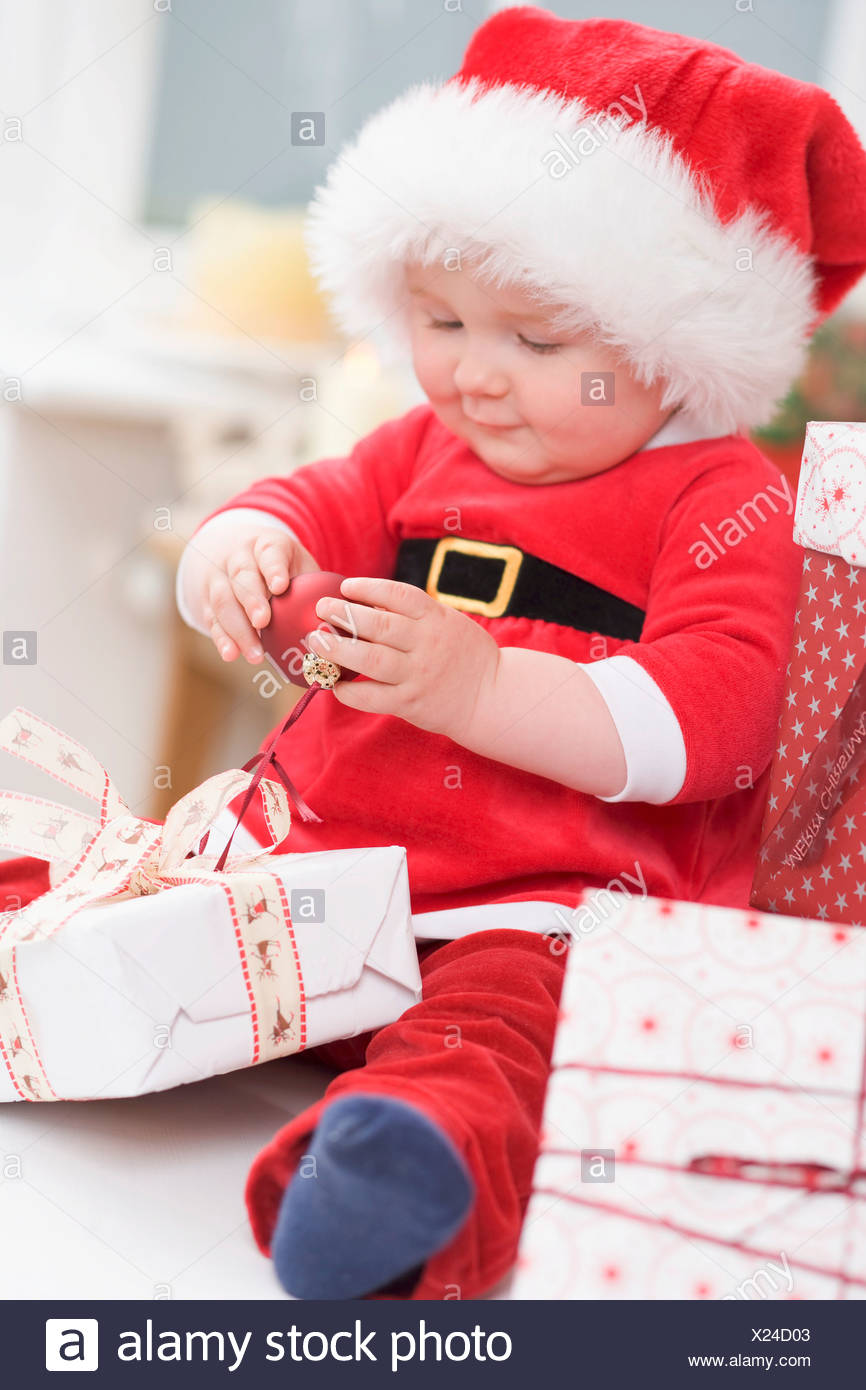 Baby with Christmas gifts Stock Photo: 276693203 - Alamy