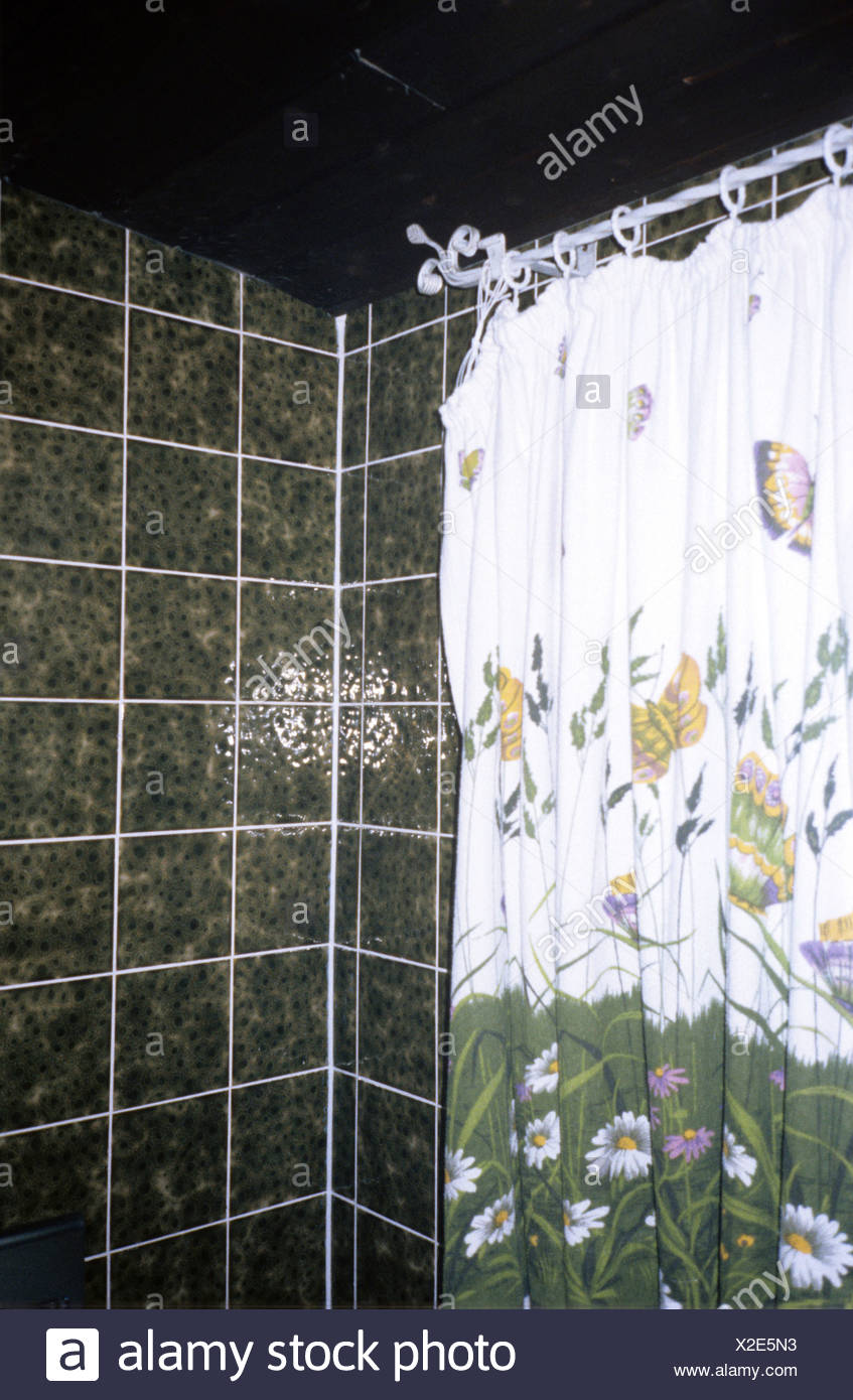 Bathroom, green tiling and bright shower curtain Stock Photo ...