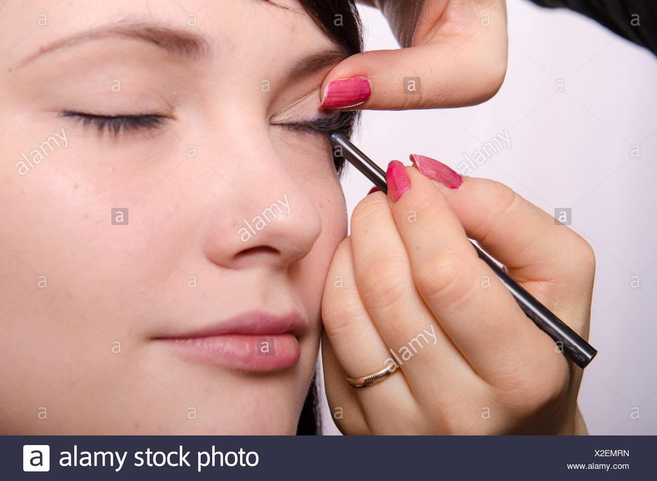 Makeup Artist Deals Makeup On The Models Face She Paints Eyelashes