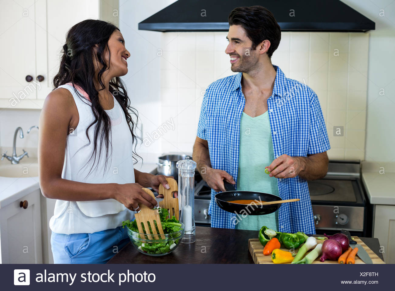 Young couple cooking food together in kitchen Stock Photo: 276931441 ...