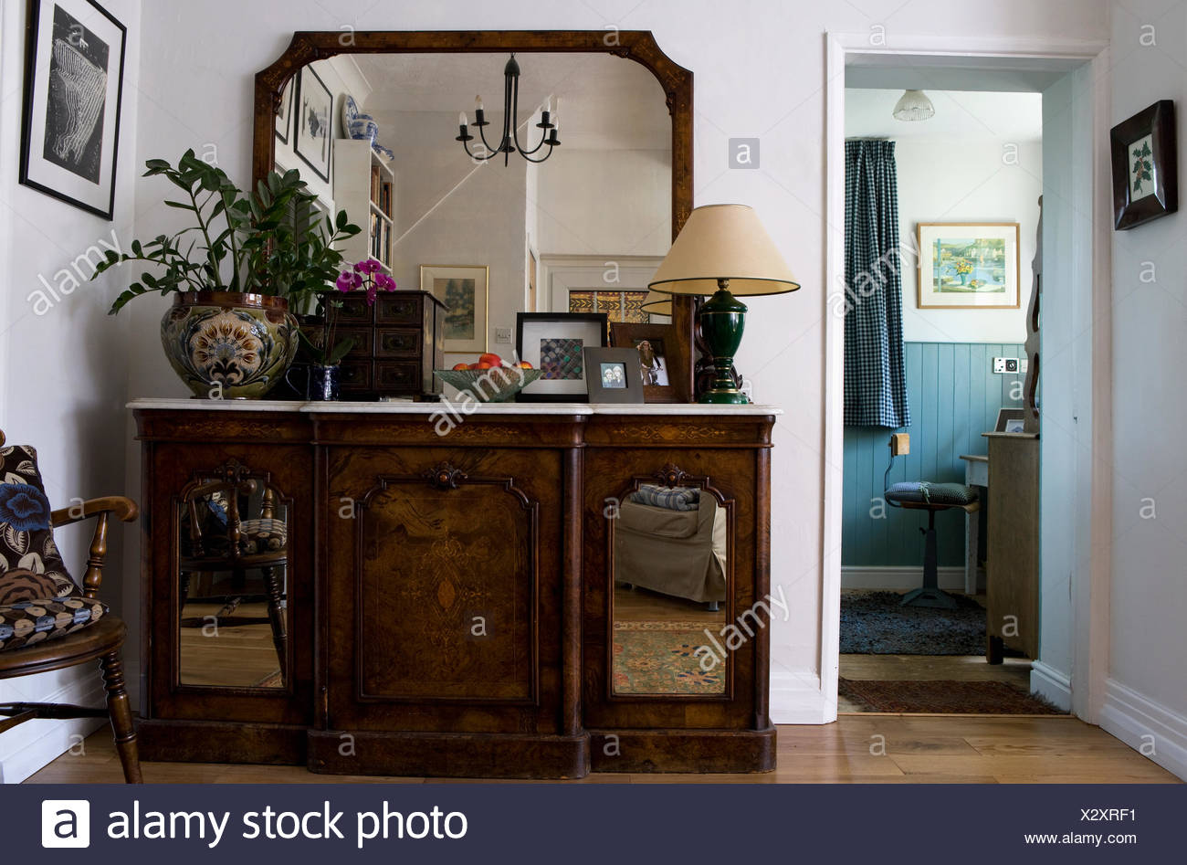Large Mirror Above Marble Topped Antique Sideboard With Mirrored Doors In  Small Living Room