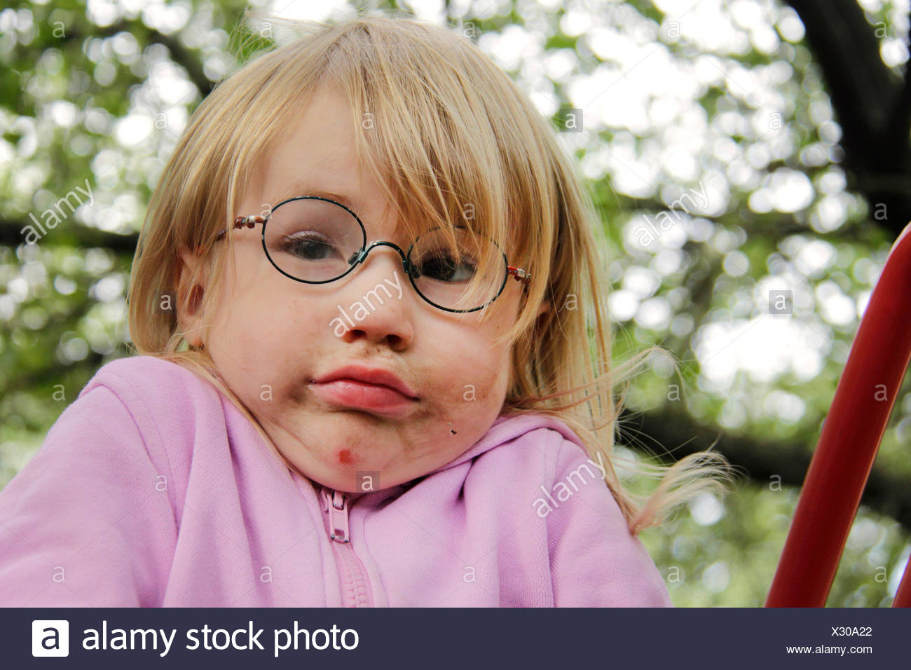 little girl with smeared face giving a shrug portrait of a child