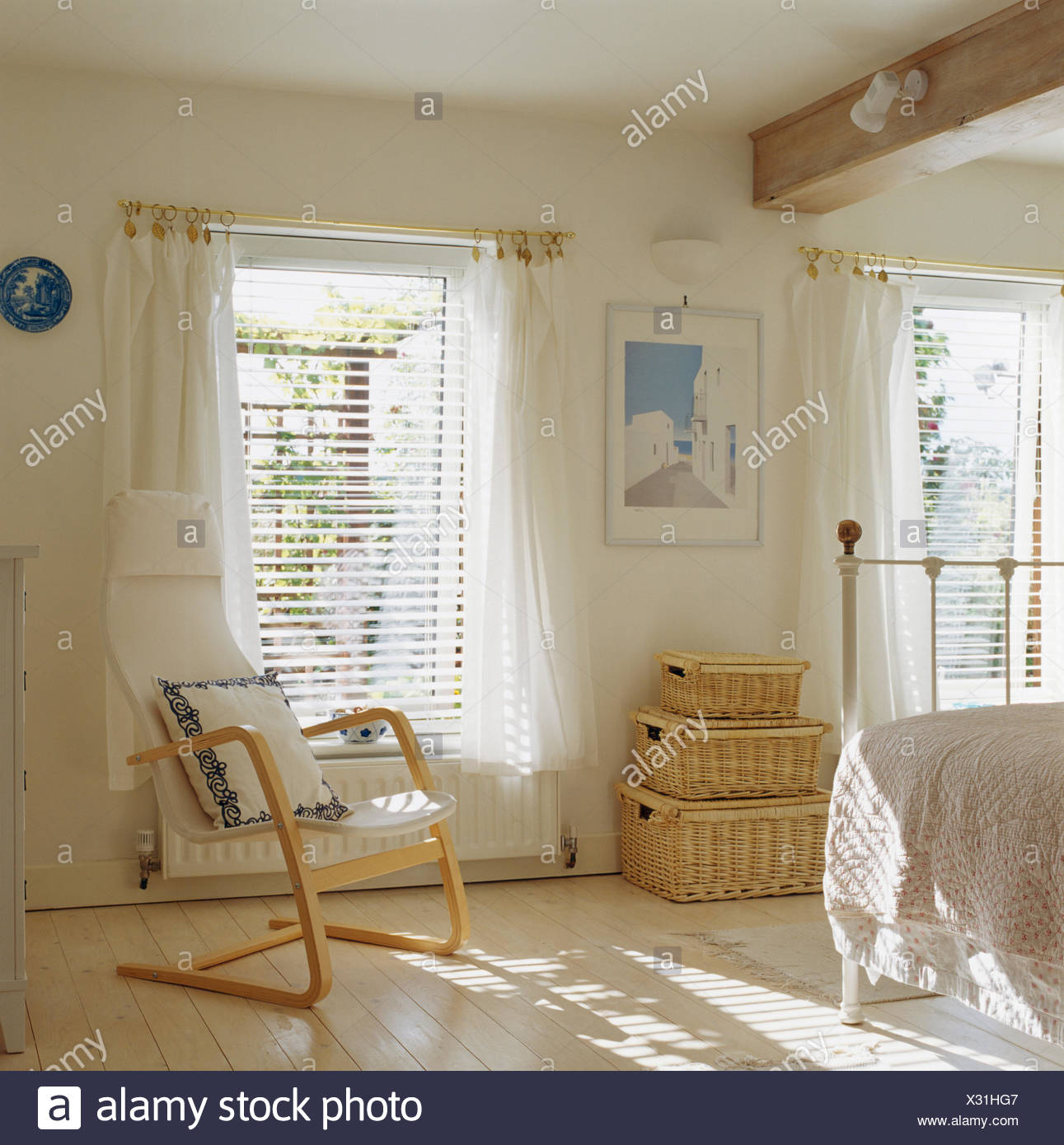 Scandinavian Style Wooden Chair And Wicker Chests In White Bedroom With  Venetian Blinds And White Voile Curtains On Window