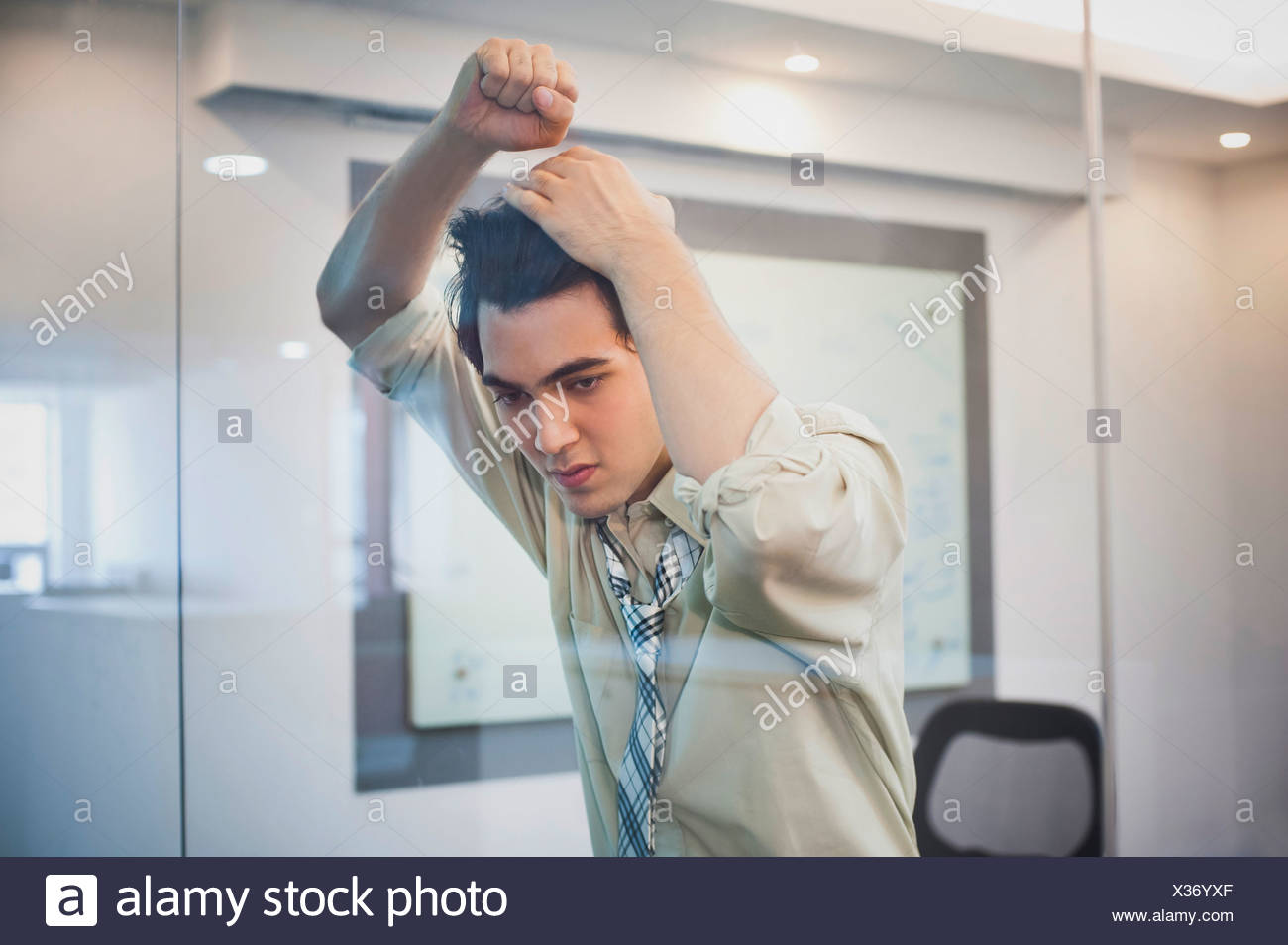 Businessman Leaning Over A Glass Door Stock Photo 277363479 Alamy